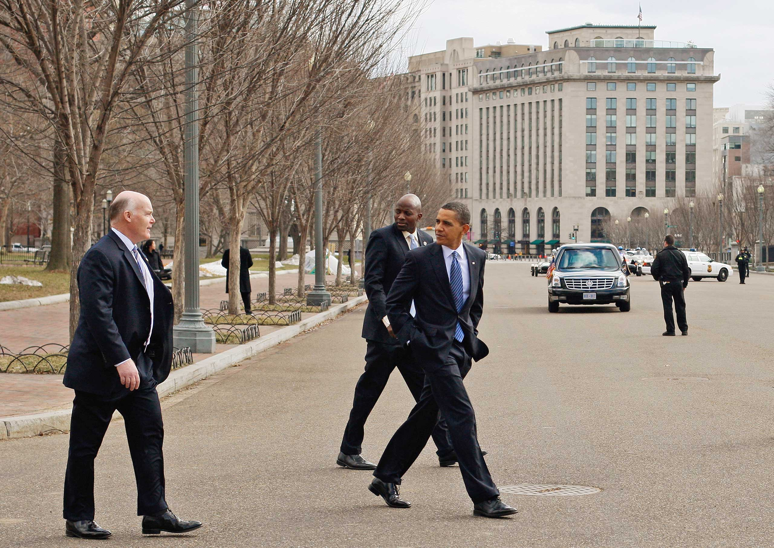 Clancy, left, crosses Pennsylvania Avenue with President Barack Obama, and Obama's aide Reggie Love, rear, while walking back to the White House in Washington D.C., on March 1, 2010.
