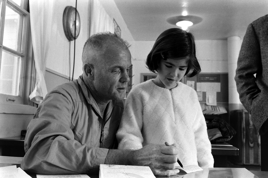 <b>Not published in LIFE. </b>Colonel John Glenn and an unidentified young girl, Marine Corps Air Station, El Toro, in southern California, 1964.