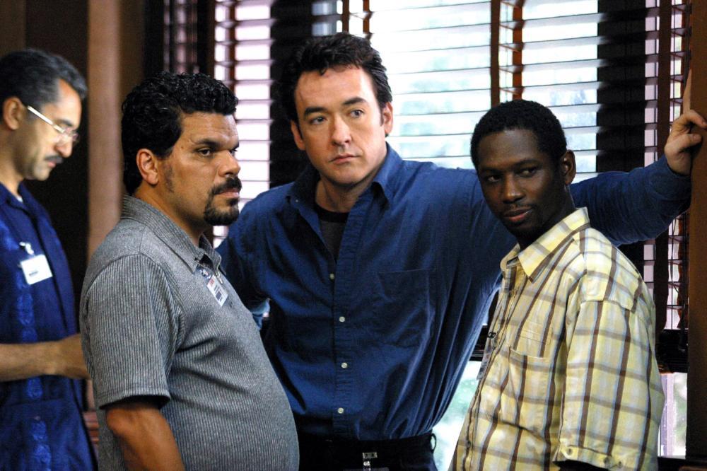 Runaway Jury, 2003 From Left: Nestor Serrano as Janovich, John Cusack as Nicholas Easter and Guy Torry as Eddie Weese