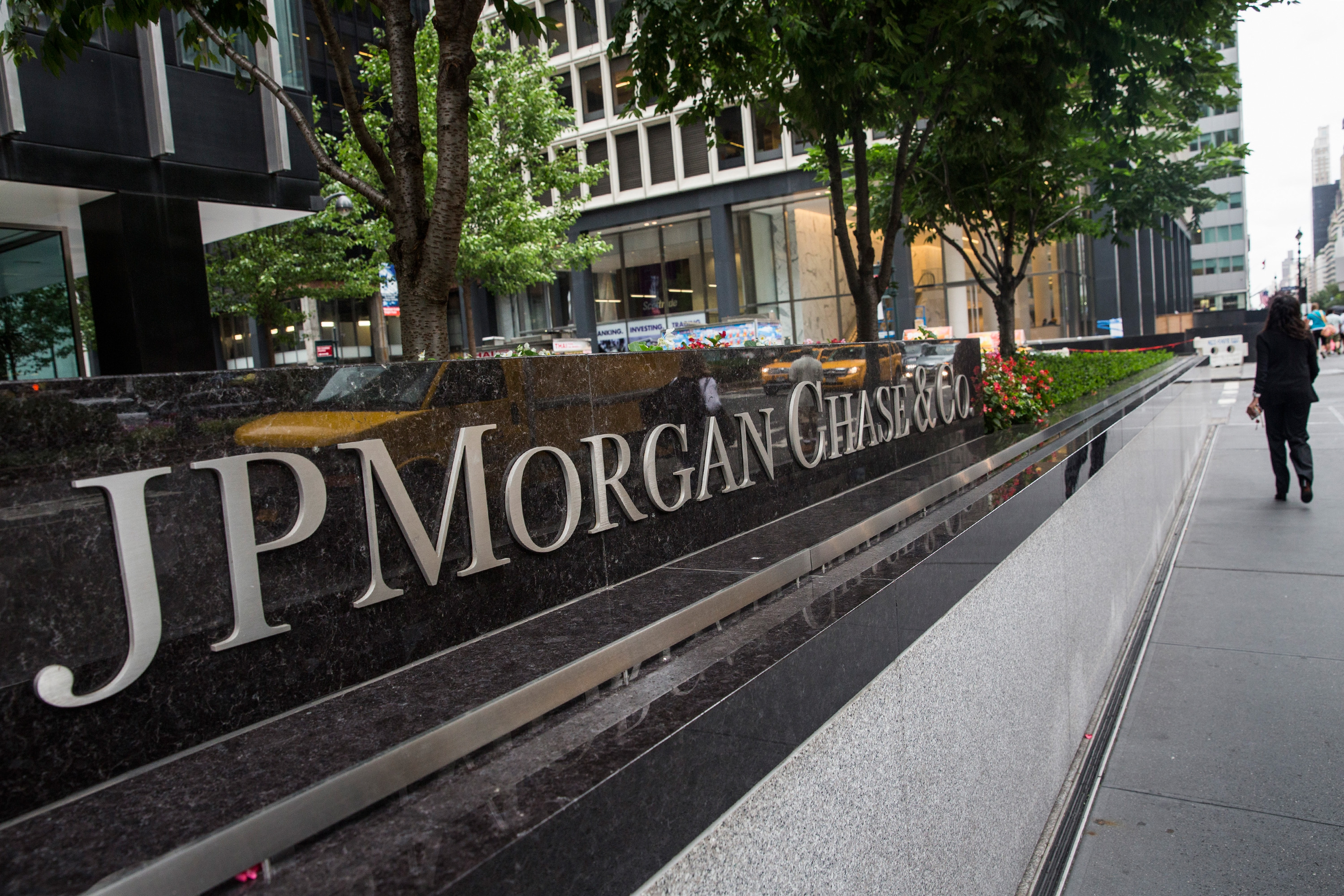 A woman walks past JP Morgan Chase's corporate headquarters on August 12, 2014 in New York City.