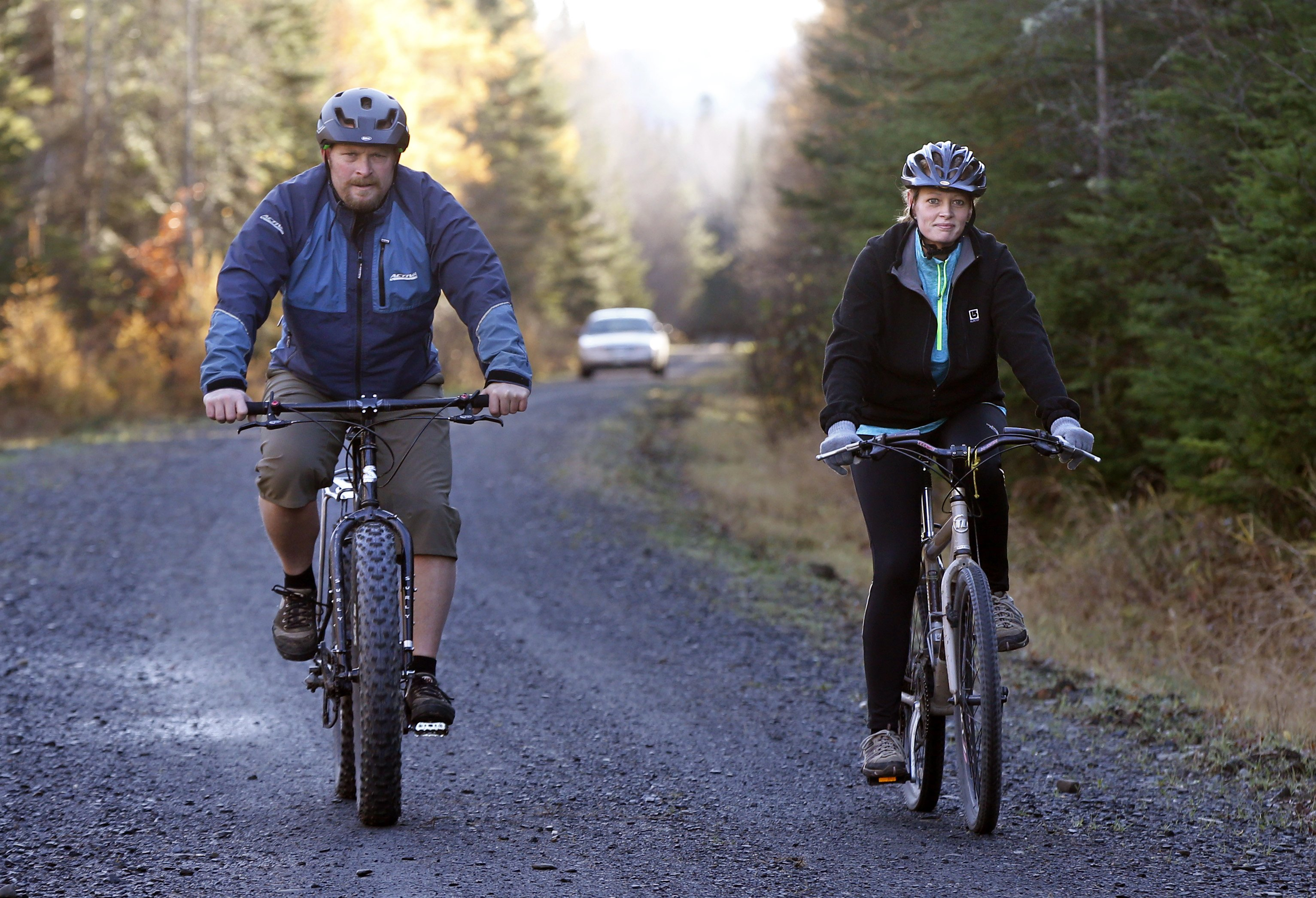 Nurse Kaci Hickox and her boyfriend Ted Wilbur are followed by a Maine state trooper as they ride bikes on a trail near her home in Fort Kent, Maine, on Oct. 30, 2014