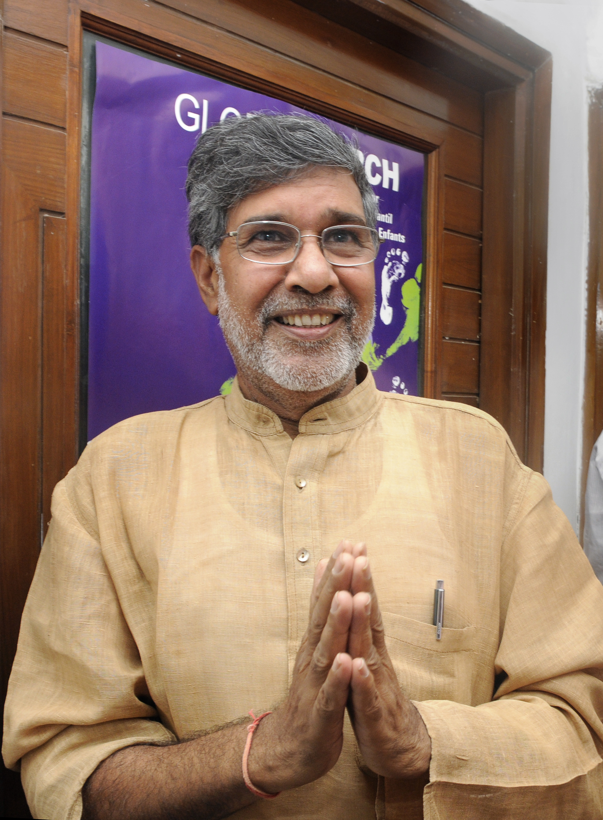 Indian childrens right activist and 2014 Nobel peace prize laureate Kailash Satyarthi greets media persons and well-wishers at his residence after the announcement of prize on October 10, 2014 in New Delhi, India.