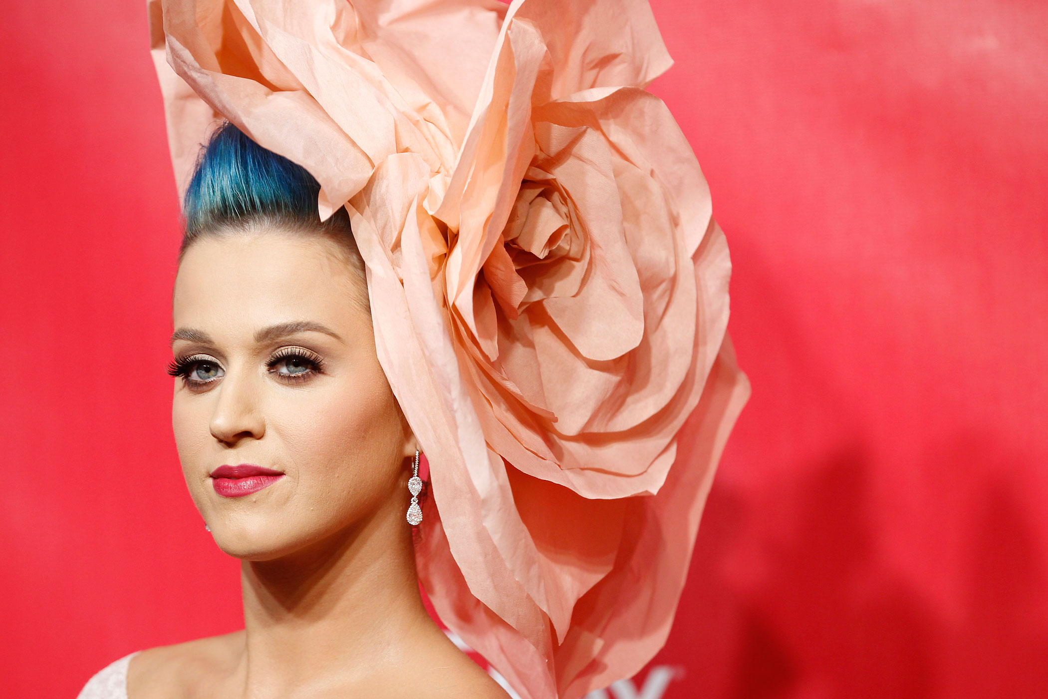 Katy Perry poses at the 2012 MusiCares Person of the Year tribute honoring Paul McCartney in Los Angeles, February 10, 2012.