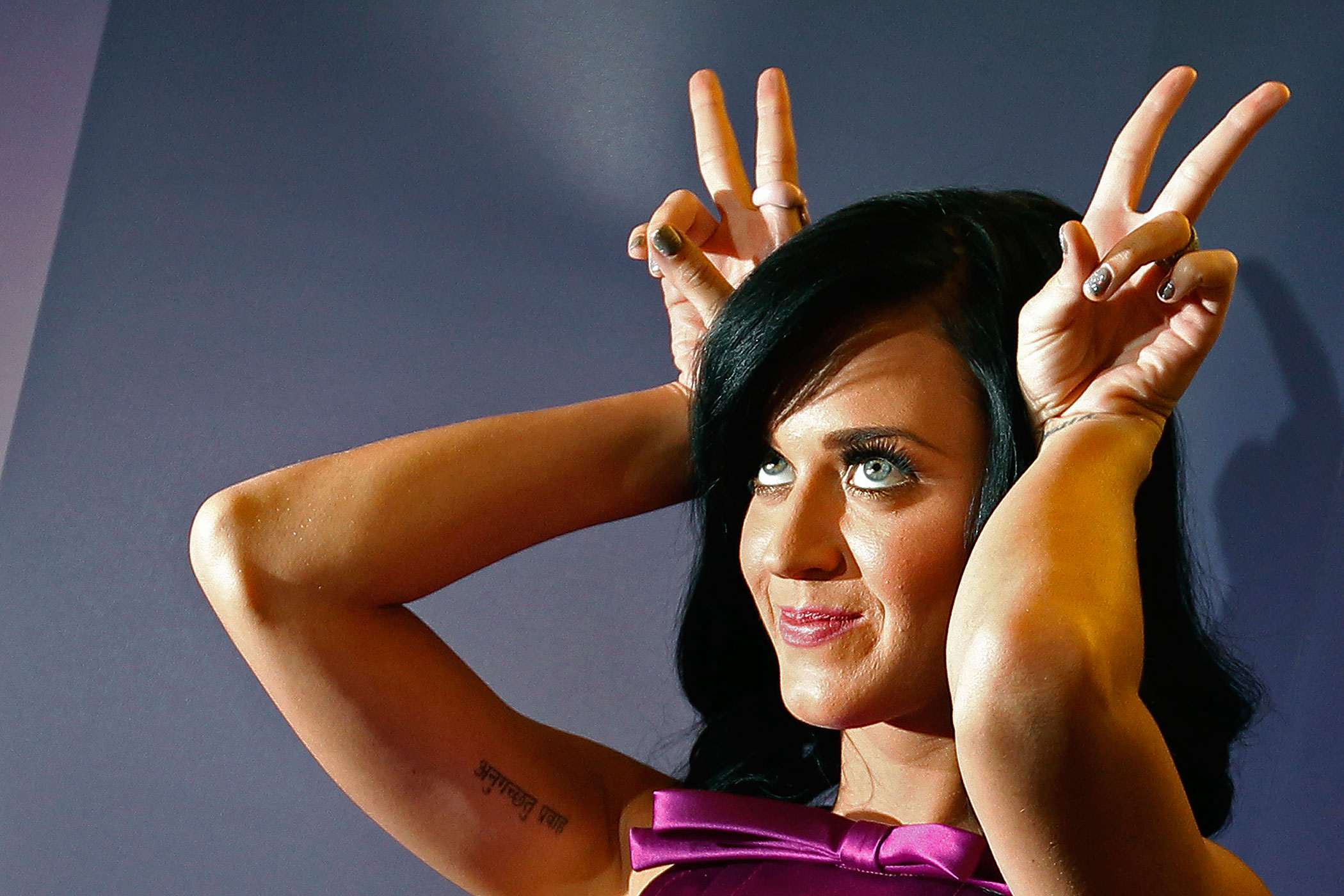 Katy Perry poses during the launch of her fragrance 'Purr' at Selfridges department store on Oxford Street in London November 12, 2010.