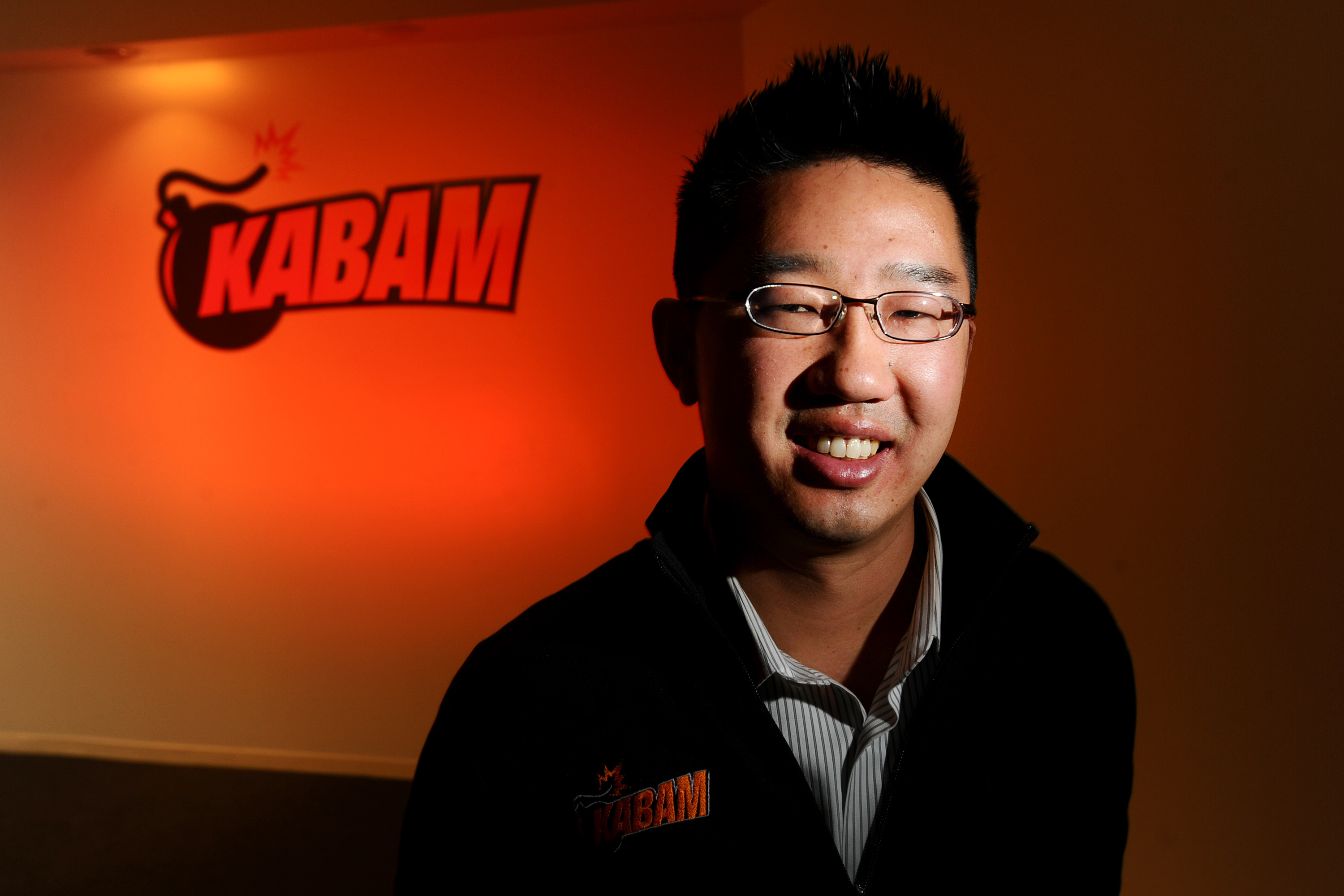 Kevin Chou, chief executive officer of Kabam Inc., stands for a photograph at the company's office in Redwood City, California.