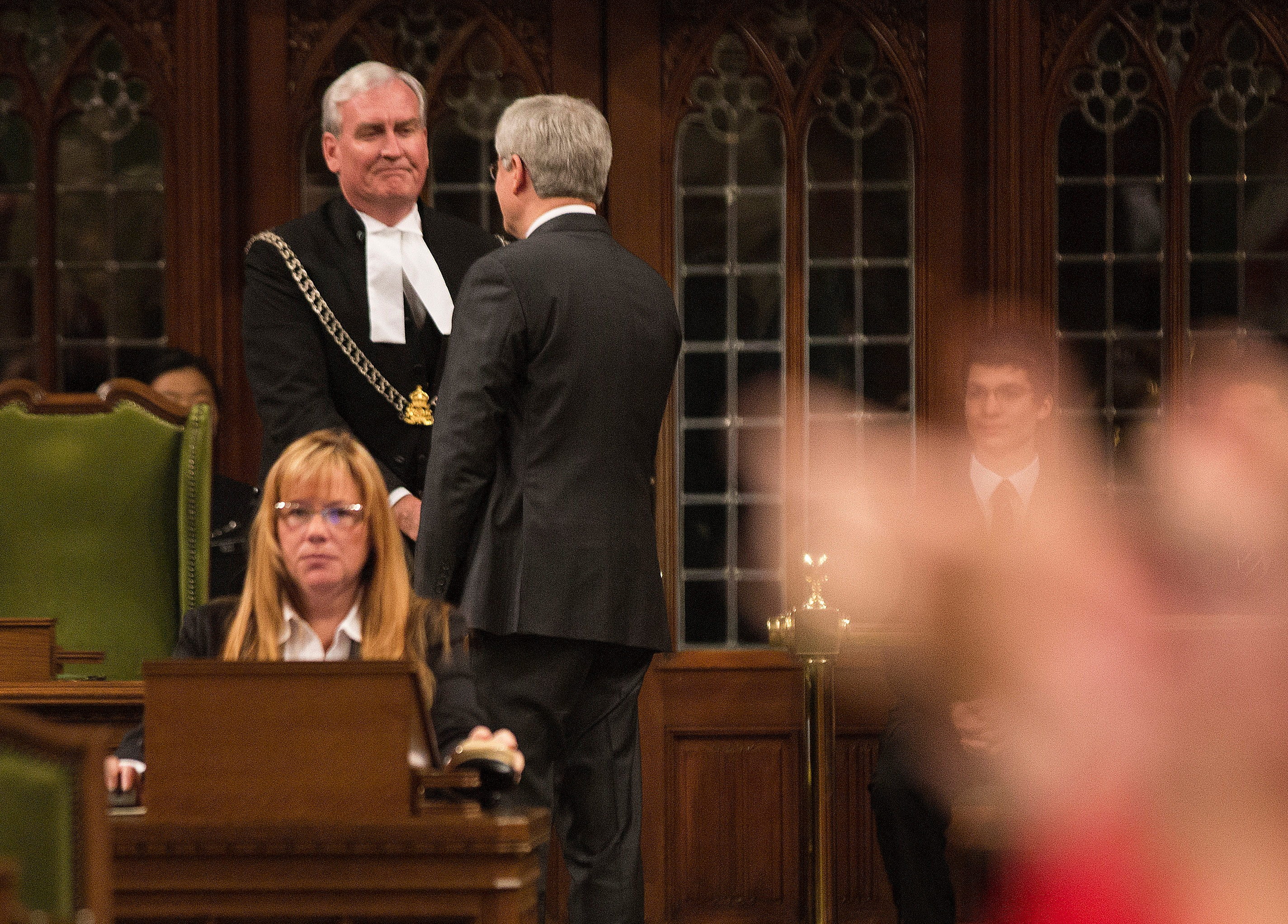 In this handout photo provided by the PMO, Prime Minister Stephen Harper shakes hands with Kevin Vickers, Sergeant-at-Arms, following his remarks in the House of Commons addressing the attacks in the Nation's Capital, on October 23, 2014 in Ottawa, Canada.