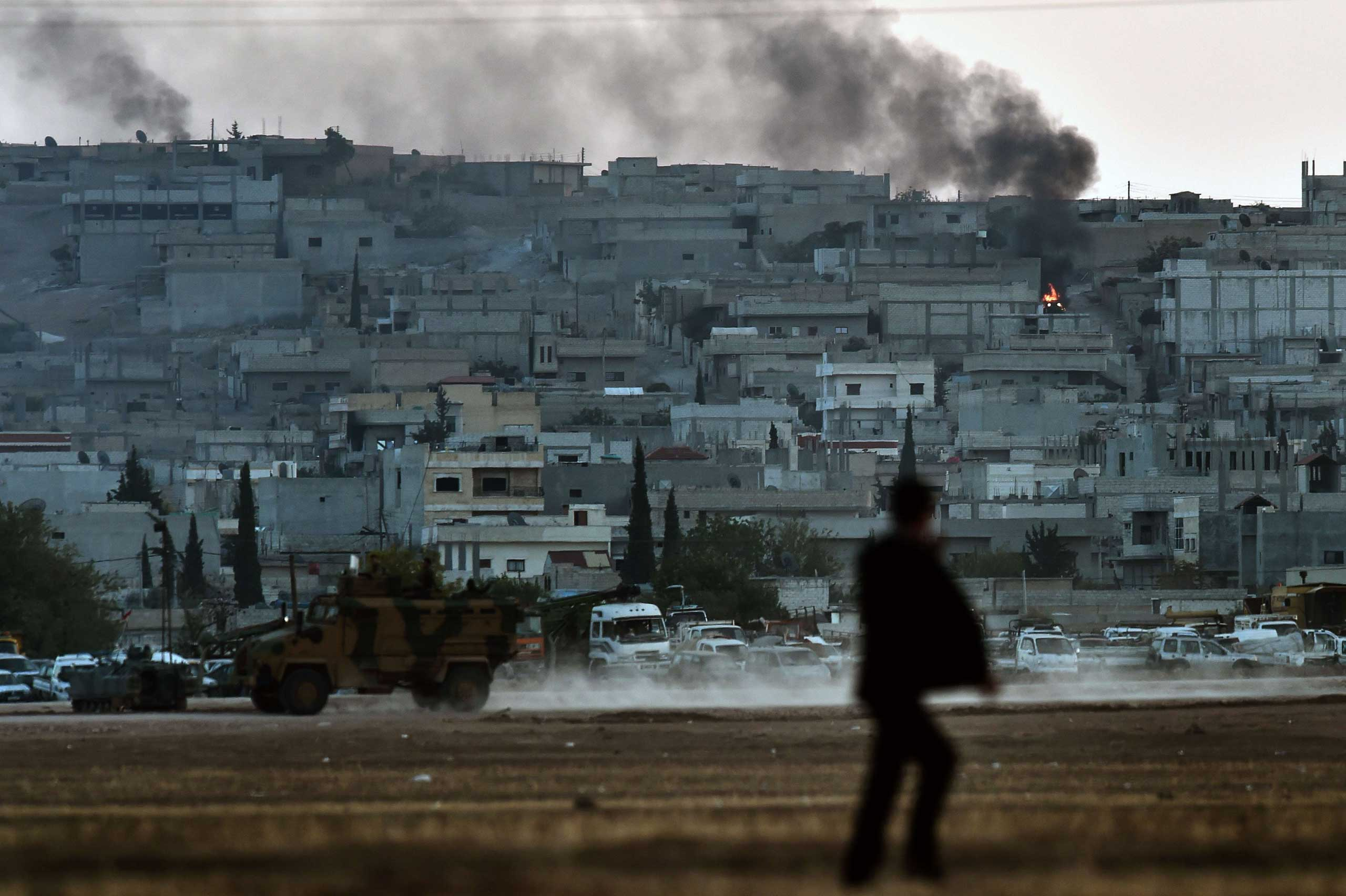 Smoke rises from the city centre of the Syrian town of Ain al-Arab, known as Kobani by the Kurds, as seen from the Turkish-Syrian border during heavy fighting, in the southeastern town of Suruc, Sanliurfa province, Turkey, on Oct. 7, 2014.