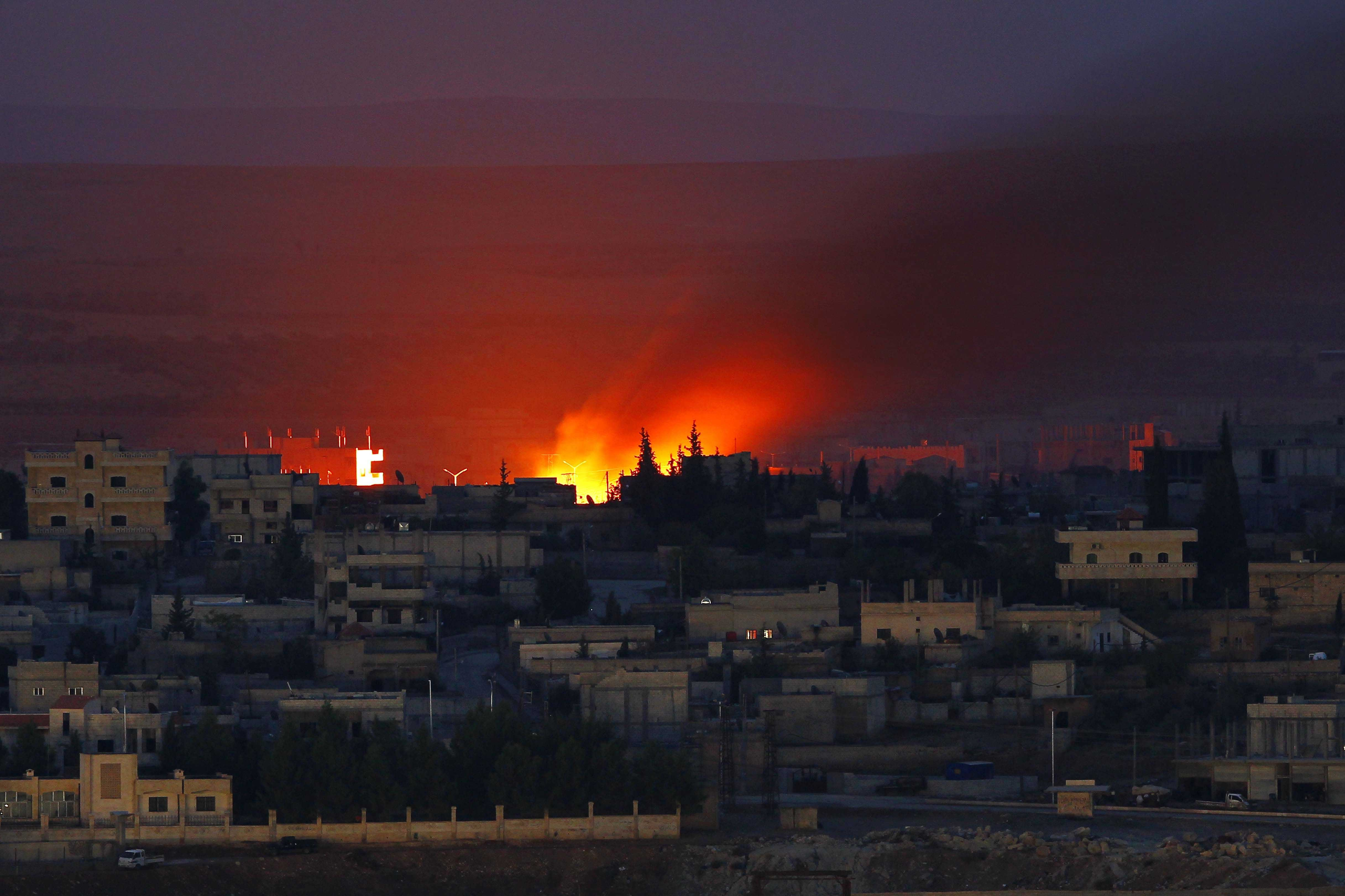 Fire is seen after an US airstrike on ISIS positions in Kobani, Syria, on Oct. 15, 2014.