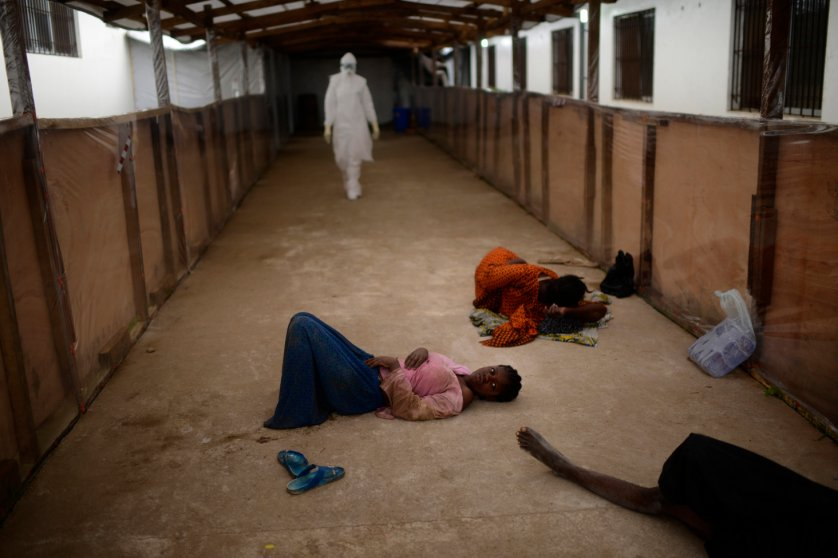 Critically ill patients wait for beds to be prepared for them at Island Clinic, Monrovia, Liberia, Sept. 24, 2014.