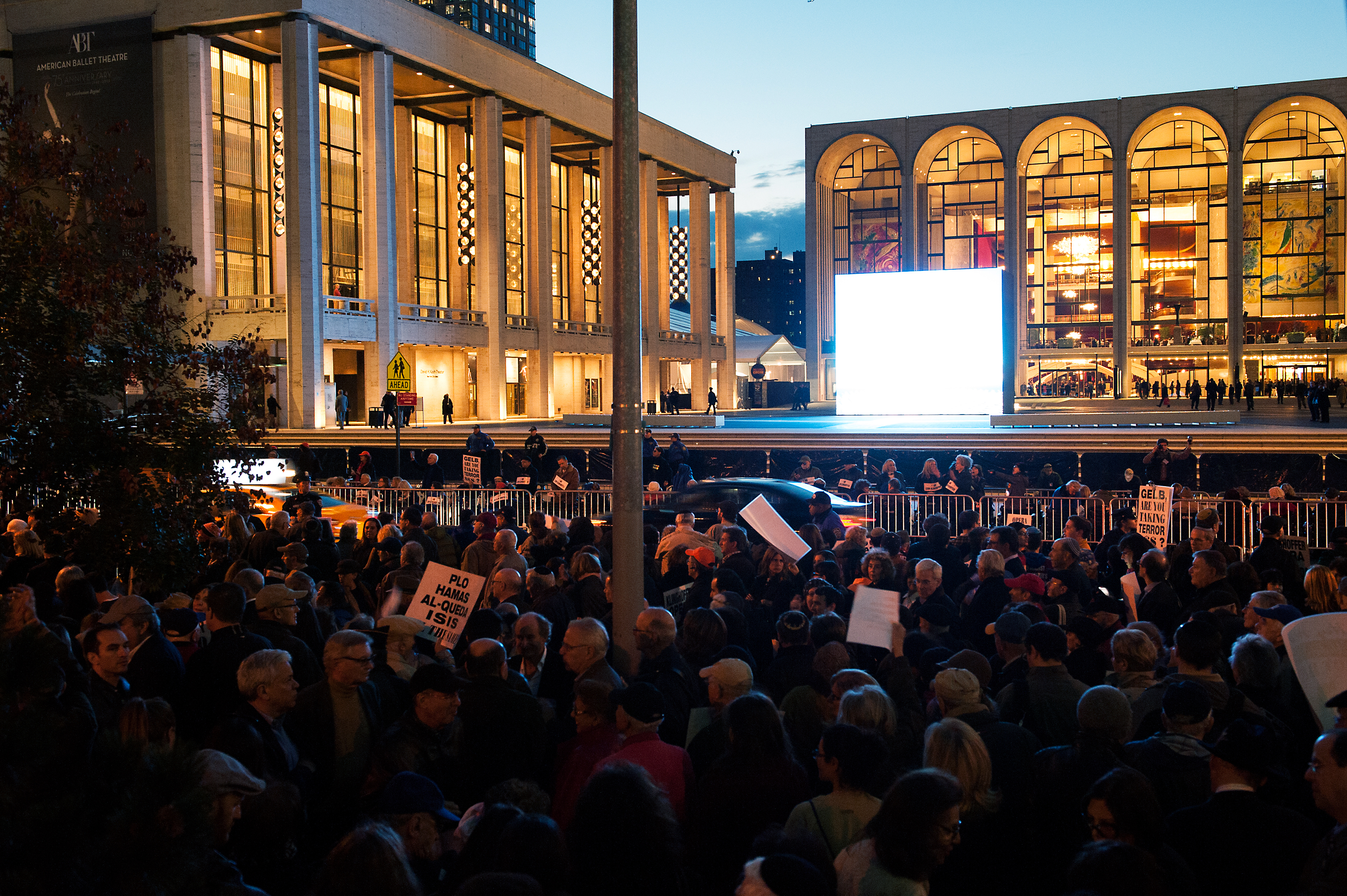 Protestors hold signs outside the Metropolitan Opera at Lincoln Center on opening night of the opera,  The Death of Klinghoffer  on October 20, 2014 in New York City. The opera has been accused of anti-Semitism and demonstrators protested its inclusion in this year's schedule at the Metropolitan Opera.