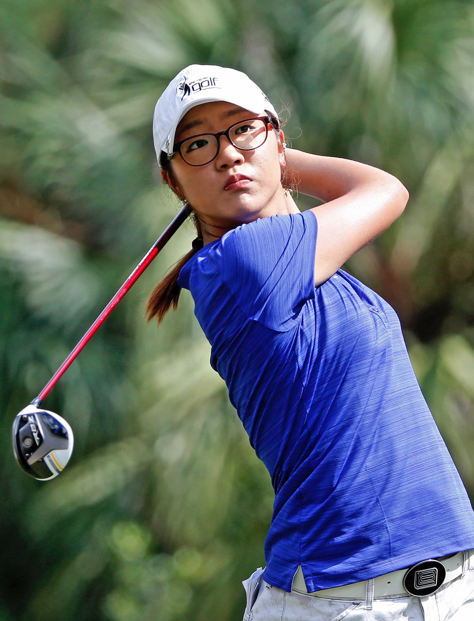 Lydia Ko of New Zealand plays a shot on the 8th hole during the first round of the CME Group Titleholders at Tiburon Golf Club on November 21, 2013 in Naples, Florida.