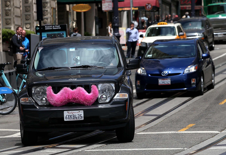 A Lyft car drives along Powell Street on June 12, 2014 in San Francisco.