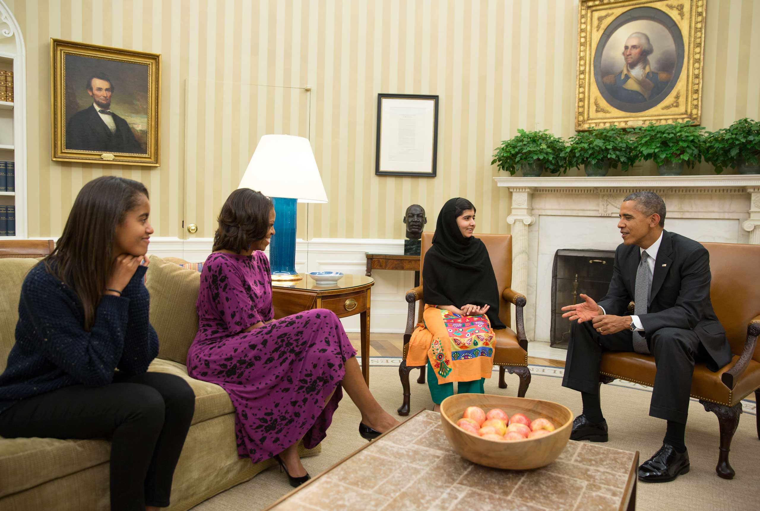 The Obama family meets with Malala Yousafzai in the Oval Office of the White House in Washington on Oct. 11, 2013.