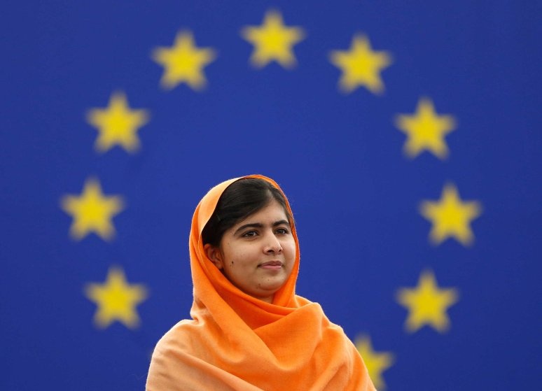 Pakistani teenage activist Malala Yousafzai, who was shot in the head by the Taliban for campaigning for girls' education, attends an award ceremony to receive her 2013 Sakharov Prize in Strasbourg