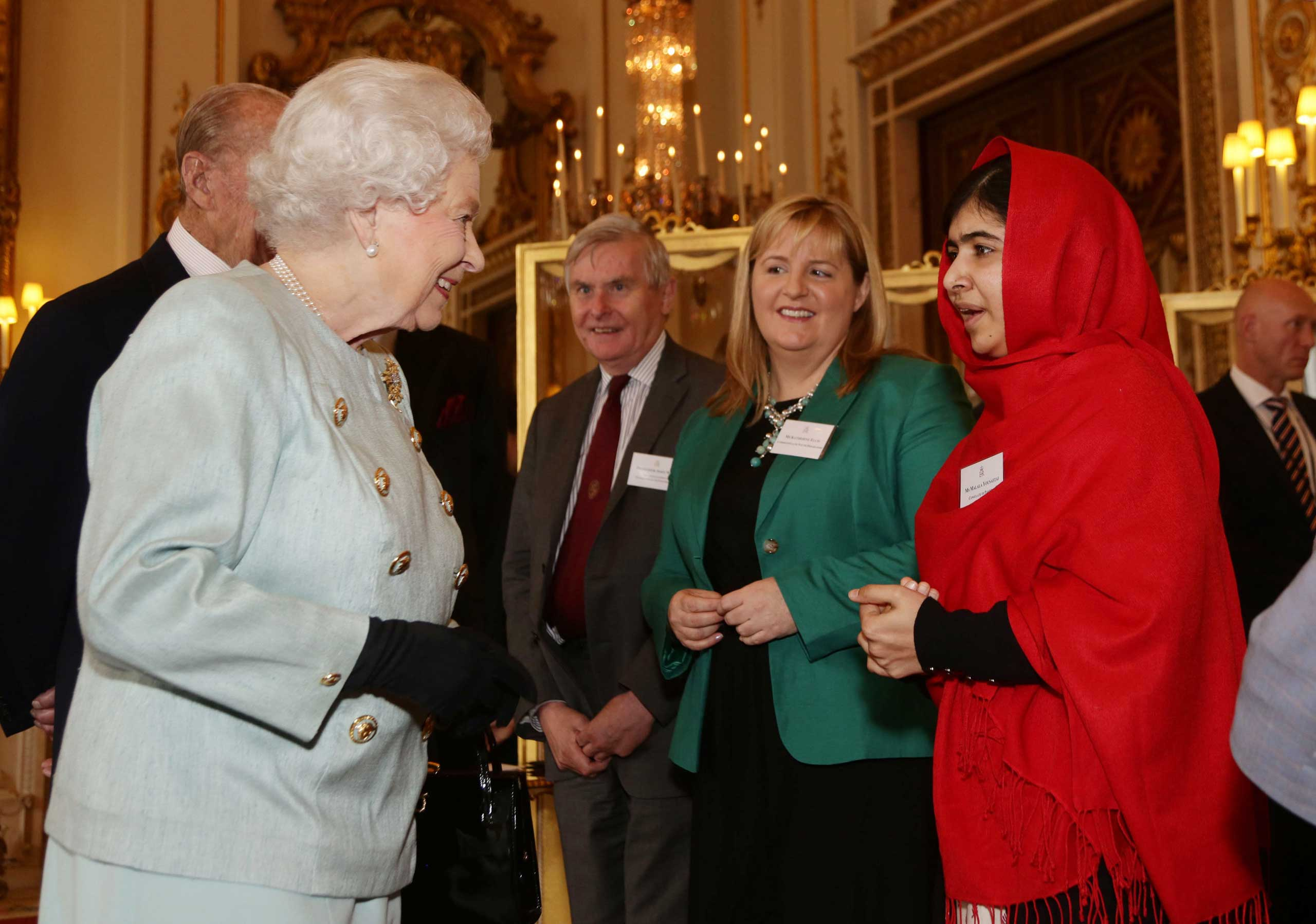 Queen Elizabeth II and Prince Philip meet Malala Yousafzai during a Reception for Youth, Education and the Commonwealth at Buckingham Palace in London on Oct. 18, 2013.