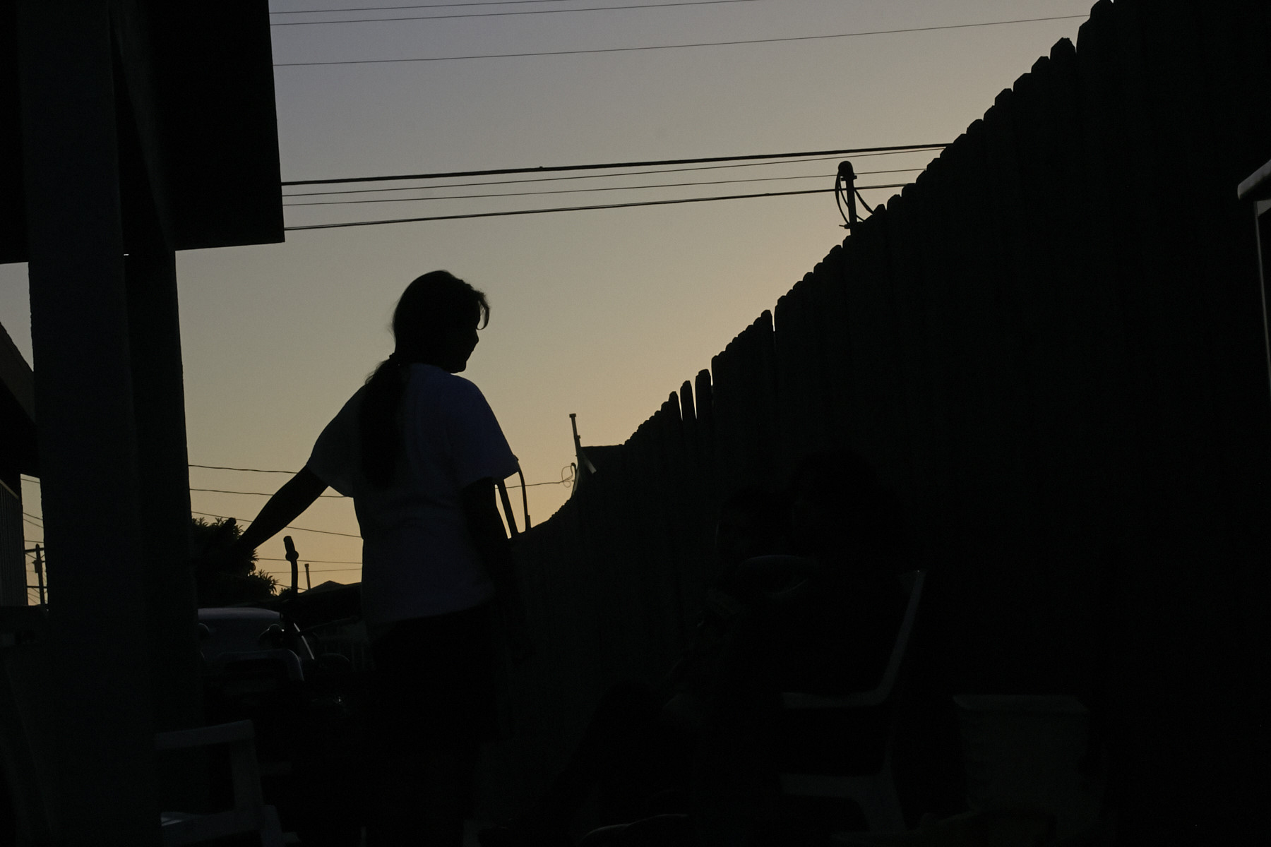 At dusk in Los Angeles, Maria, 15, waits for word on                    her plea for asylum from extortion and gang threats in El Salvador.