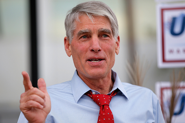 U.S. Sen. Mark Udall (D-CO) speaks to supporters as he kicks off his 'Mark Your Ballot' bus tour on Oct. 15, 2014 in Denver.