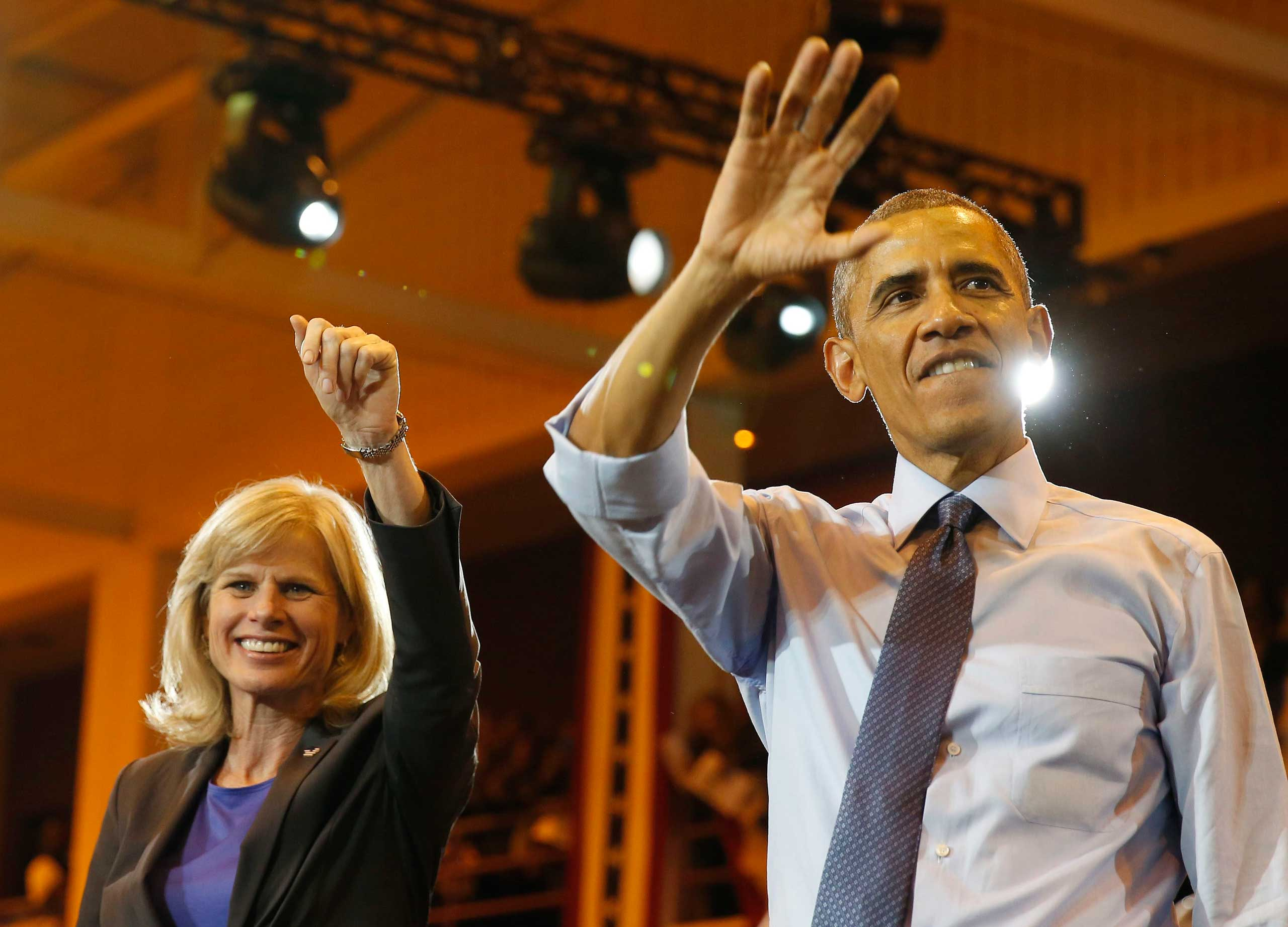 President Obama attends a campaign event with Democratic candidate for Wisconsin Gov. Mary Burke while at North Division High School in Milwaukee, Oct. 28, 2014.