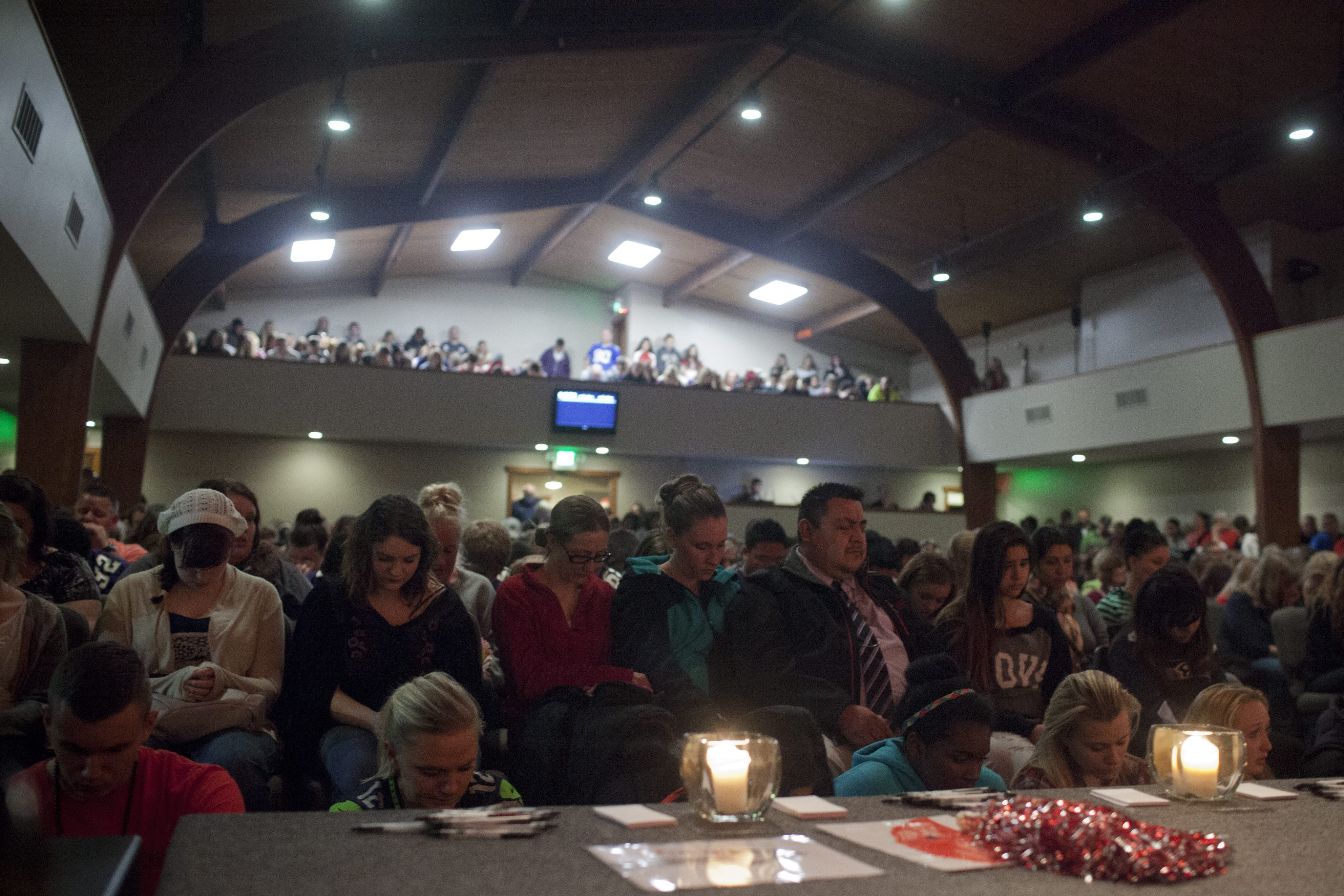 Students and community members attend a vigil at the Grove Church, after a school shooting that occurred at Marysville-Pilchuck High School earlier in the day in Marysville, Wash., on Oct. 24, 2014