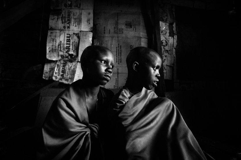 Two Maasai girls, a day before their planned circumcision. Kenya.