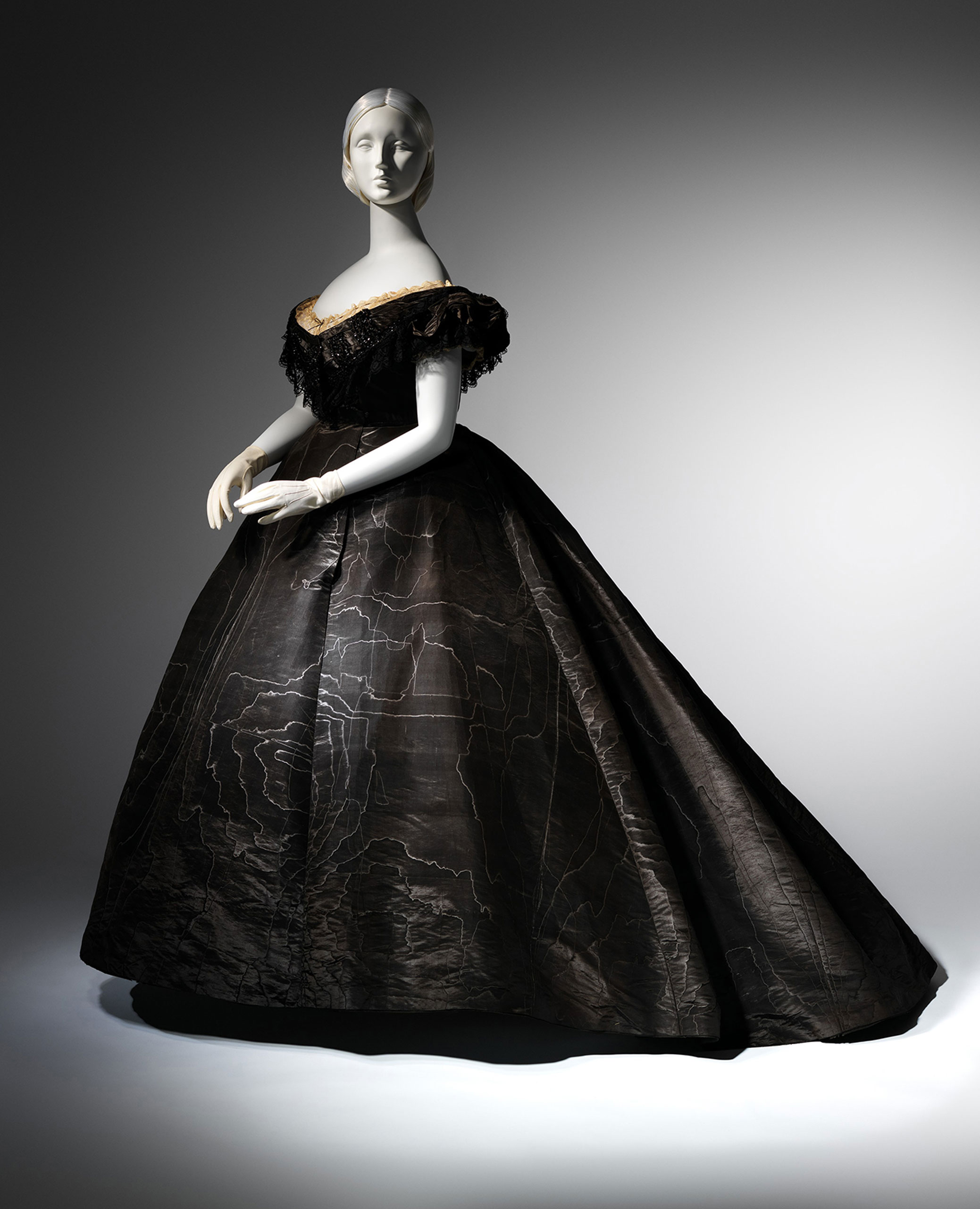 <strong>Evening dress, ca. 1861</strong>                                    Black moire silk, black jet, black lace