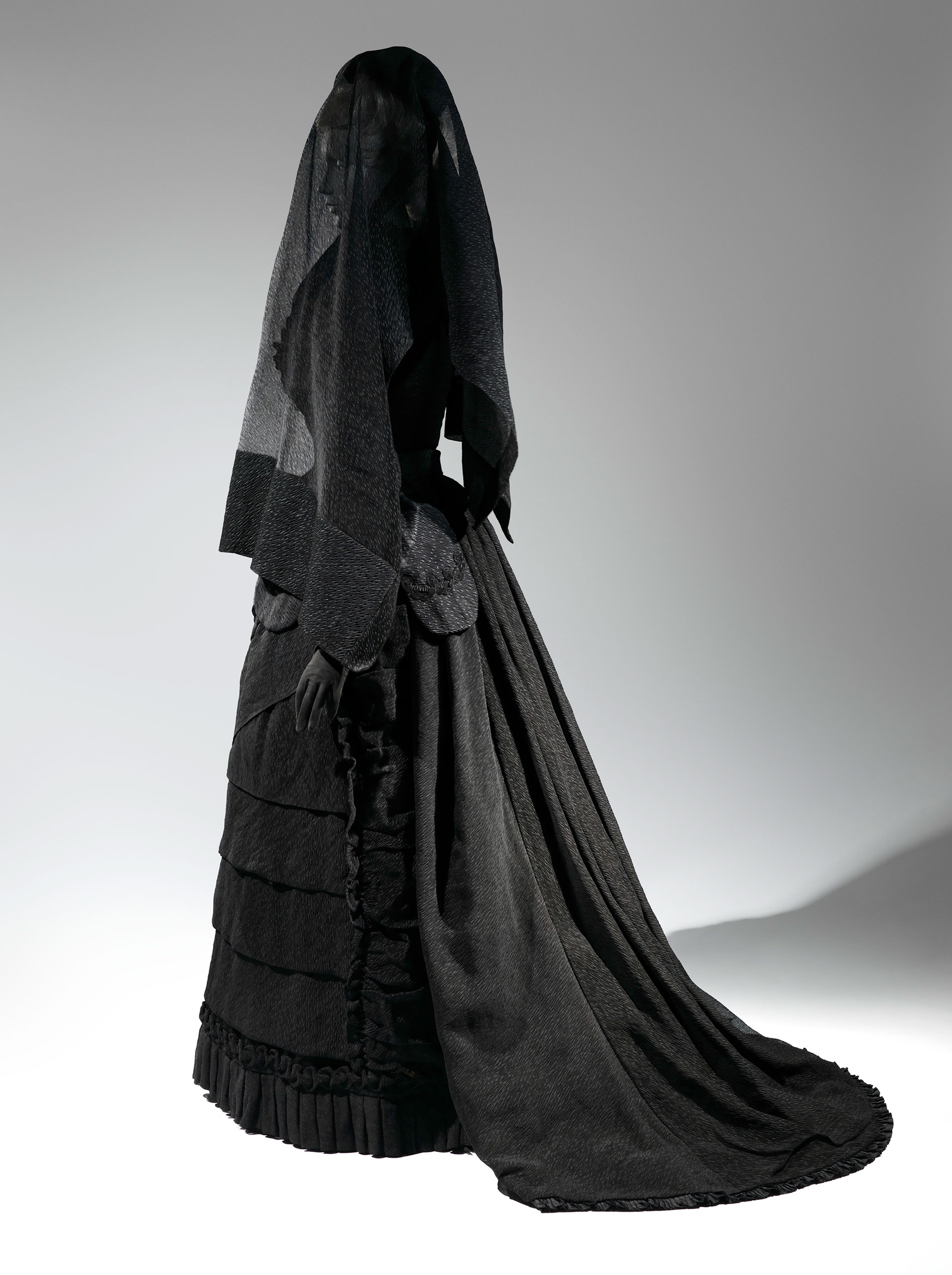<strong>Mourning Ensemble, 1870-1872; Veil, ca. 1875</strong>                                    Black silk crape, black mousseline; Black silk crape
