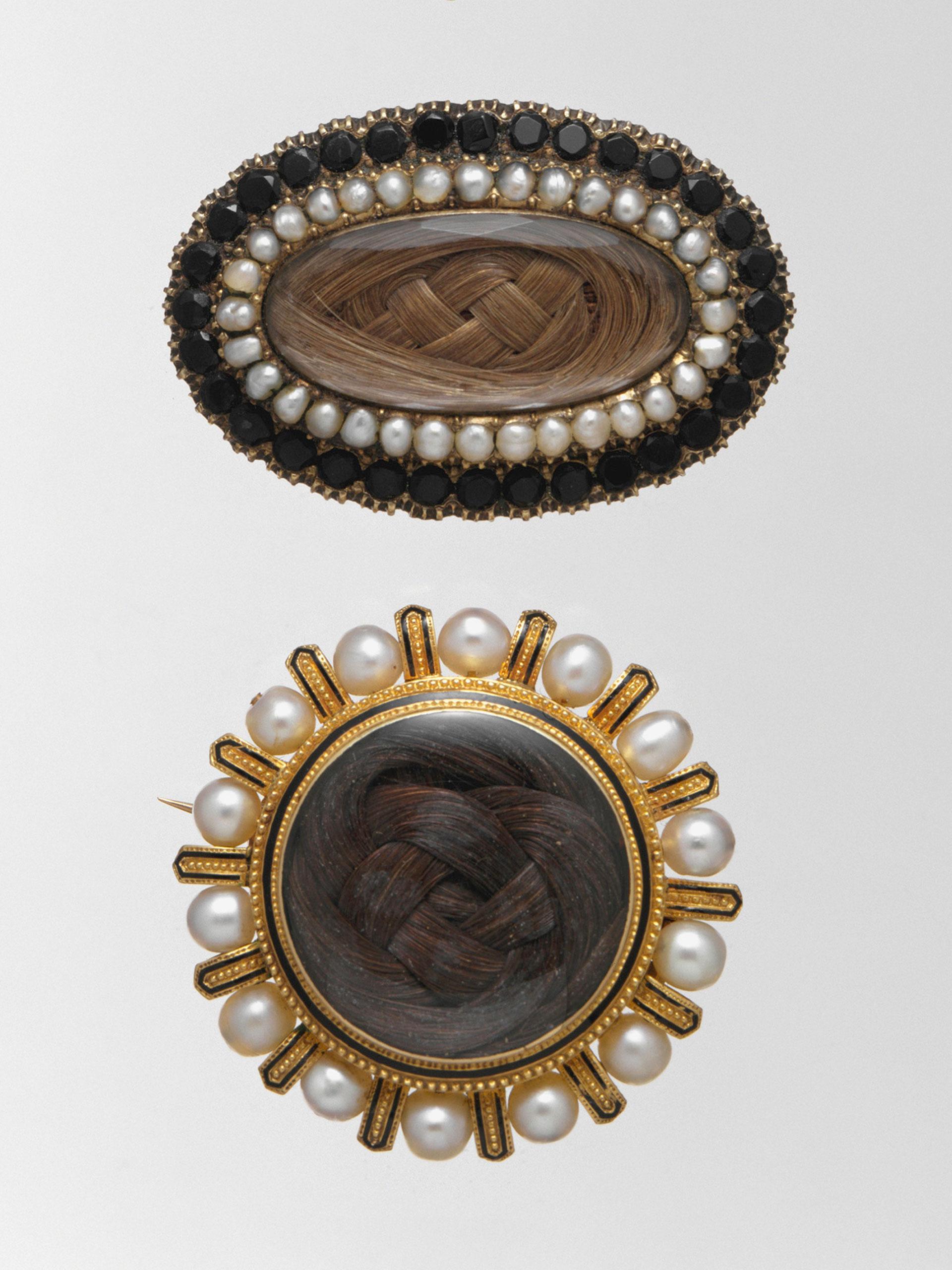 <strong>Brooch, ca. 1850; Tiffany &amp; Co. Brooch, ca. 1868</strong>                                    Gold, jet, pearls, crystal, hair; Gold, pearls, black enamel, hair