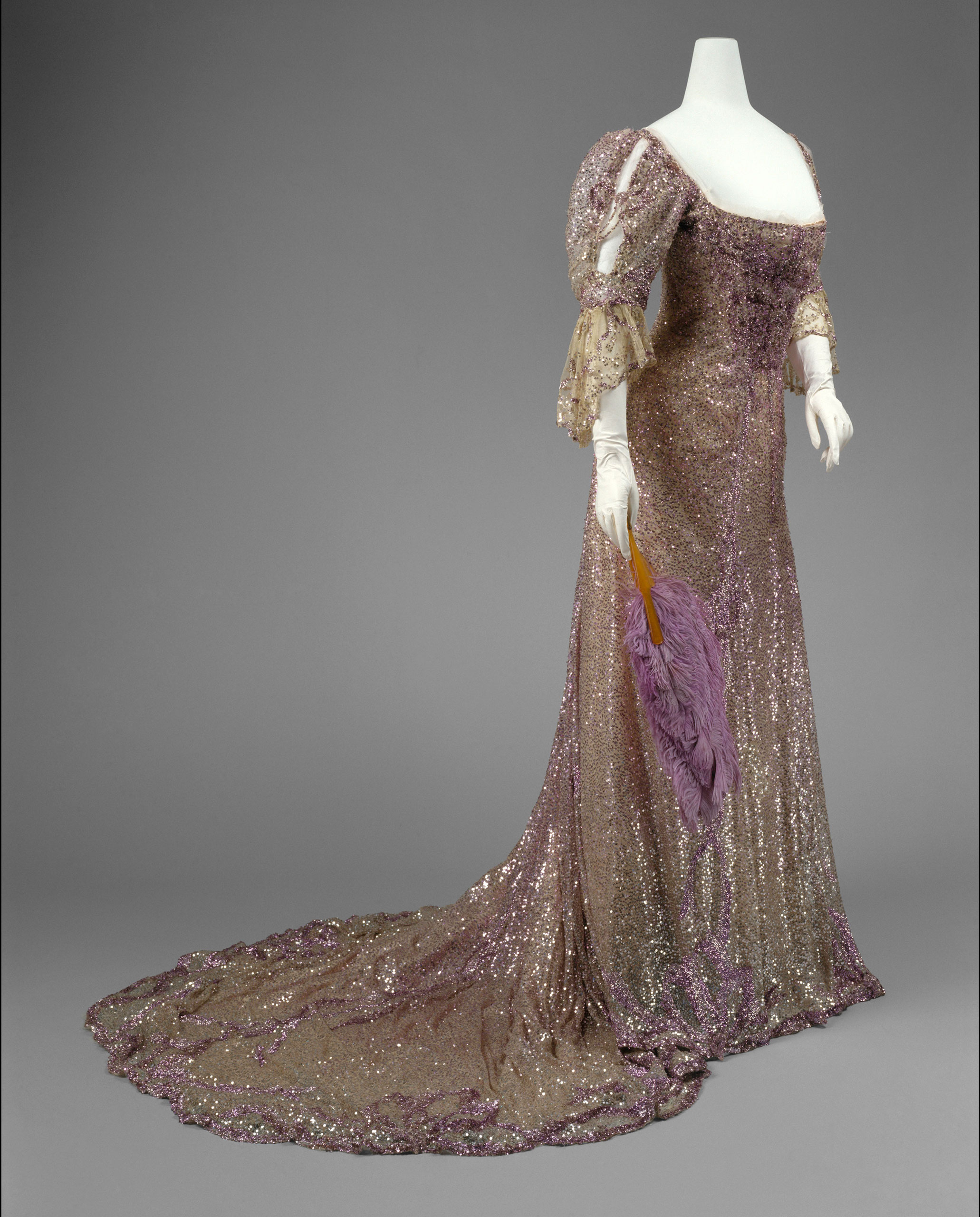<strong>Evening Dress, 1902</strong>                                    Mauve silk tulle, sequins. <i>*Worn by Queen Alexandra</i>
