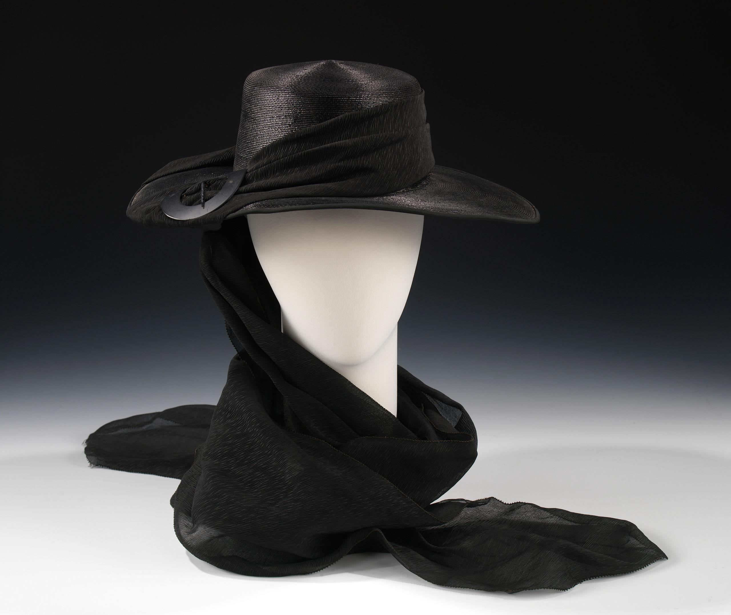 <strong>Henri Bendel Mourning Hat, ca. 1915</strong>                                    Black straw, black silk, plastic, metal