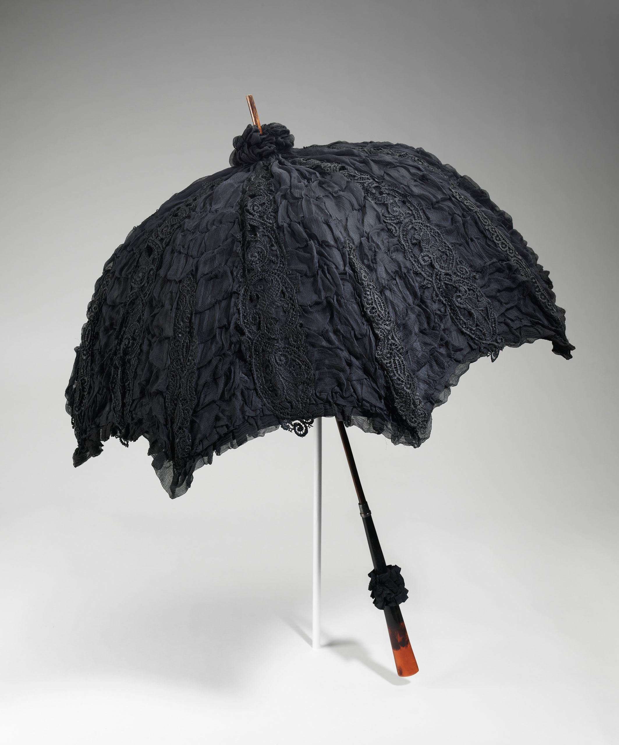 <strong>Mourning Parasol, 1895-1900</strong>                                    Black silk, wood, metal, tortoiseshell