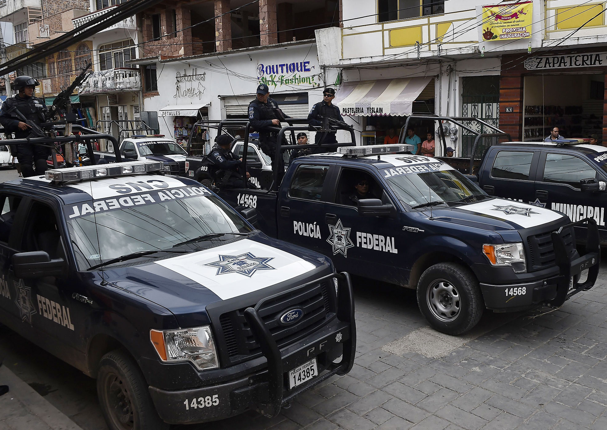 Members of the Mexican federal police are seen in a street in Teloloapan, Mexico, on Oct. 19, 2014