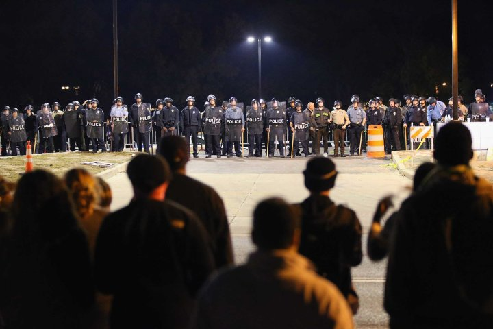 Police face off with demonstrators outside the police station as protests continue in the wake of 18-year-old Michael Brown's death on Oct. 22, 2014 in Ferguson, Missouri.