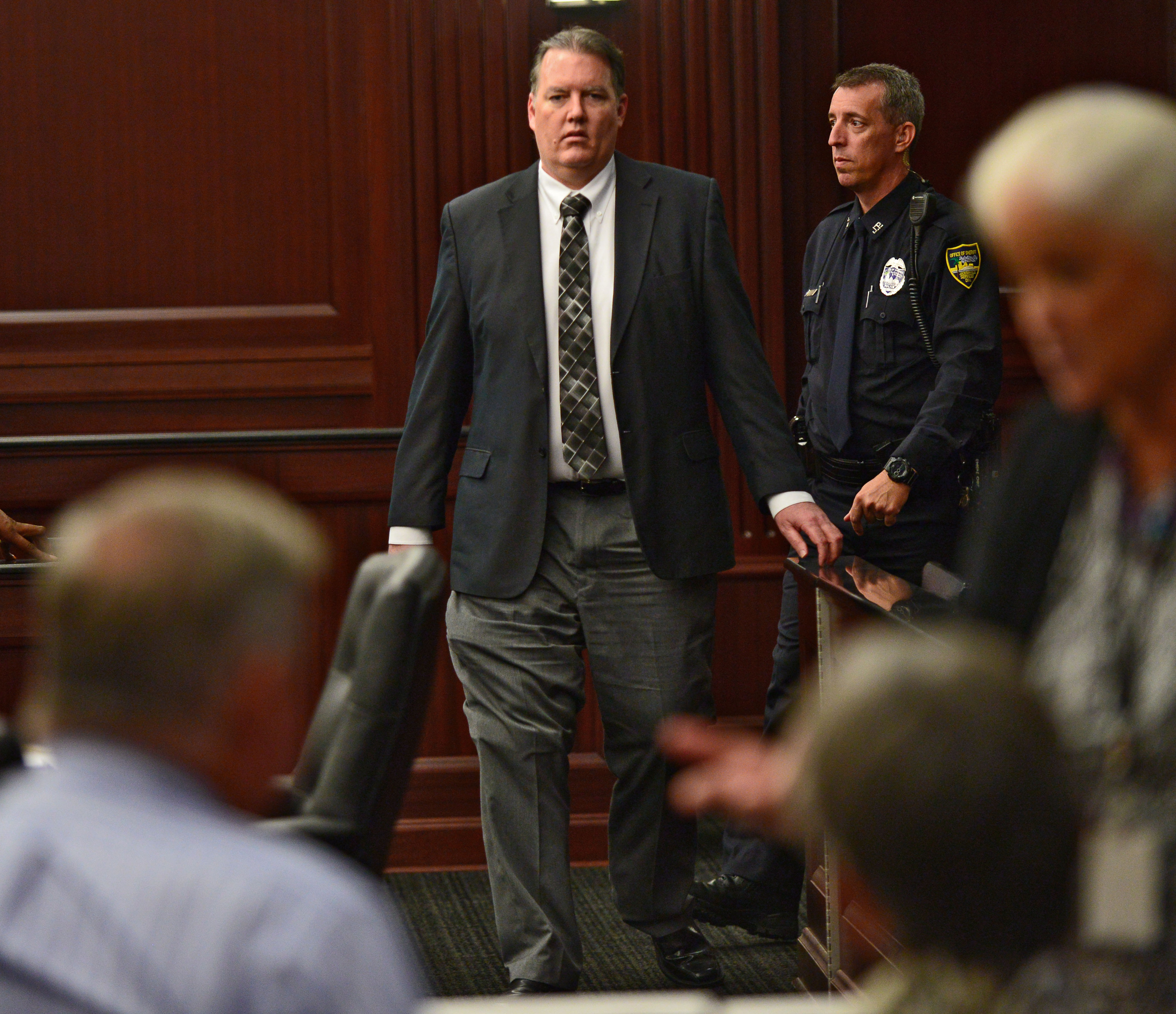 Defendant Michael Dunn walks back into the courtroom after a short afternoon break during his trial in the Duval County Courthouse in Jacksonville, Fla. on Sept. 27, 2014.