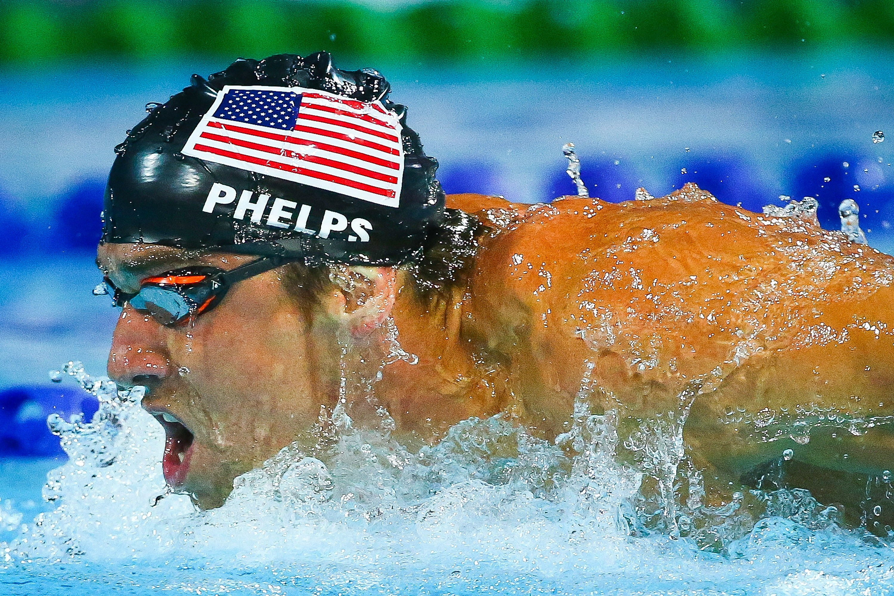 American swimmer Michael Phelps competes during the men's 4 x 100m individual medley final in  Gold Coast, Australia, on Aug. 24, 2014