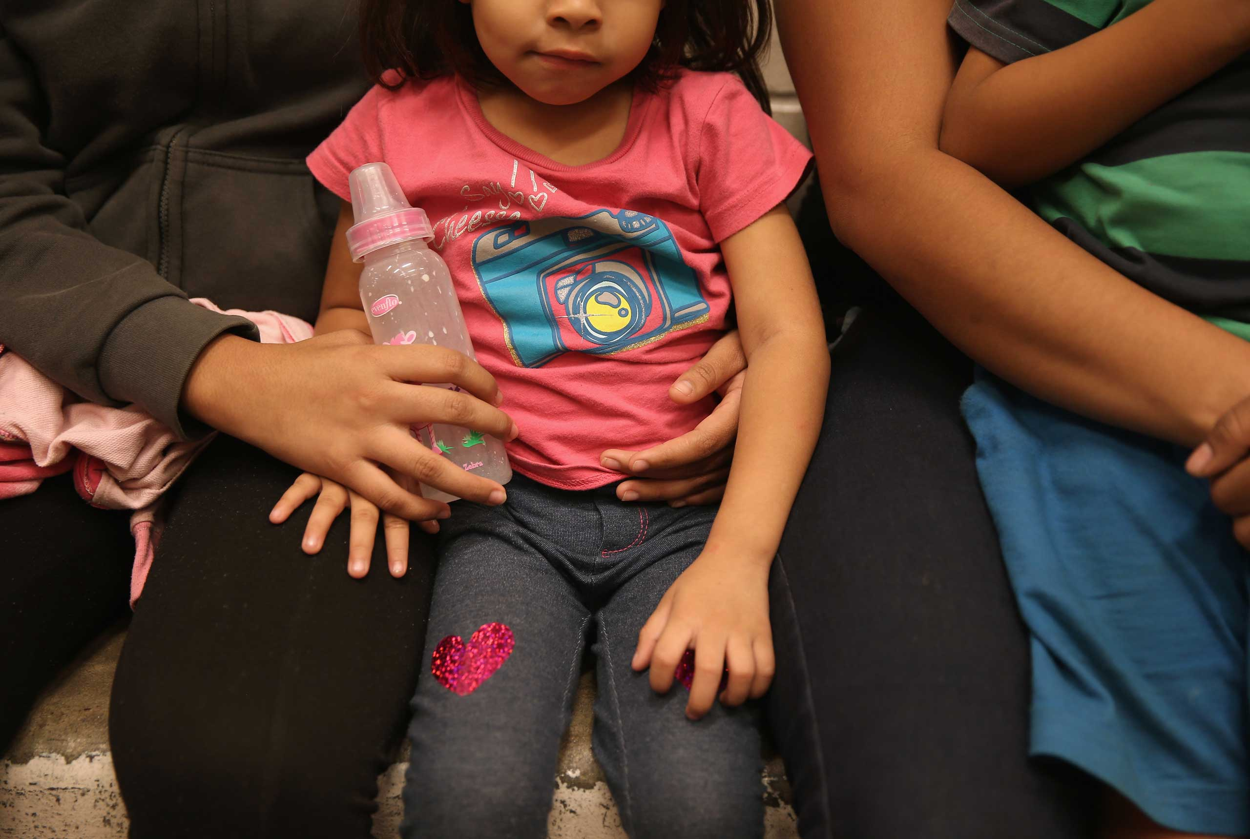 Women and children sit in a holding cell at a U.S. Border Patrol processing center after being detained by agents near the U.S.-Mexico border on Sept. 8, 2014 near McAllen, Texas.