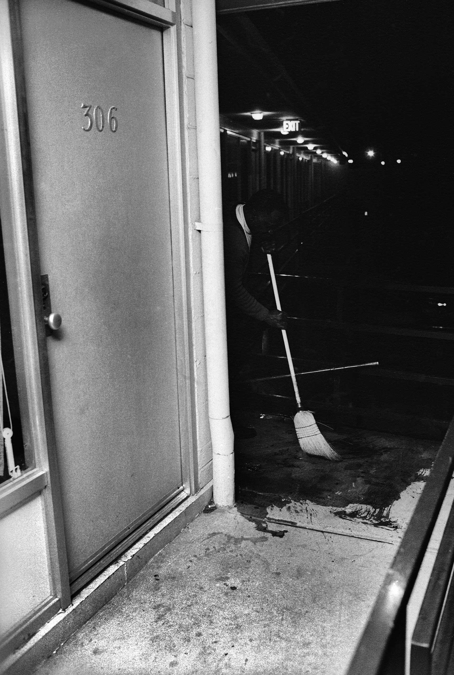"""<b>Not published in LIFE.</b> Outside of room 306, Theatrice Bailey, the brother of the Lorraine Motel's owner, cleans blood from the balcony. """"There was no friction with the people there at the Lorraine,"""" Groskinsky recalled, """"even though here was this white man with a camera on the scene."""""""