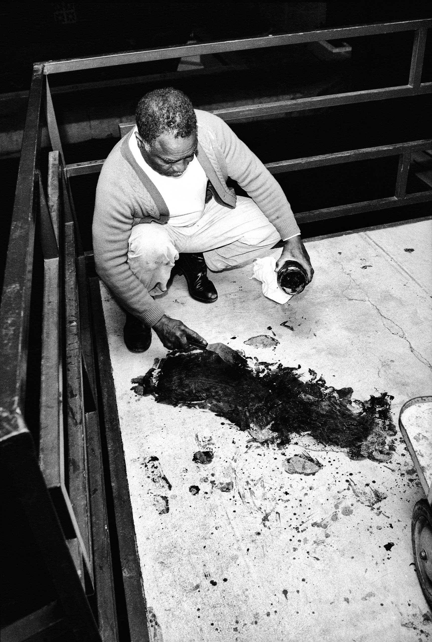 """<b>Not published in LIFE.</b> Theatrice Bailey attempts to clean blood from the balcony, hours after the 6 PM shooting of Dr. King. """"I don't know if there were official people around taking notes and pictures and things like that,"""" Groskinsky told LIFE.com. """"Nobody was there when we were there. But the fact that the blood was still on the floor, and this man was actually putting it in a jar ... well, when you see a picture like that, God, it feels invasive."""""""