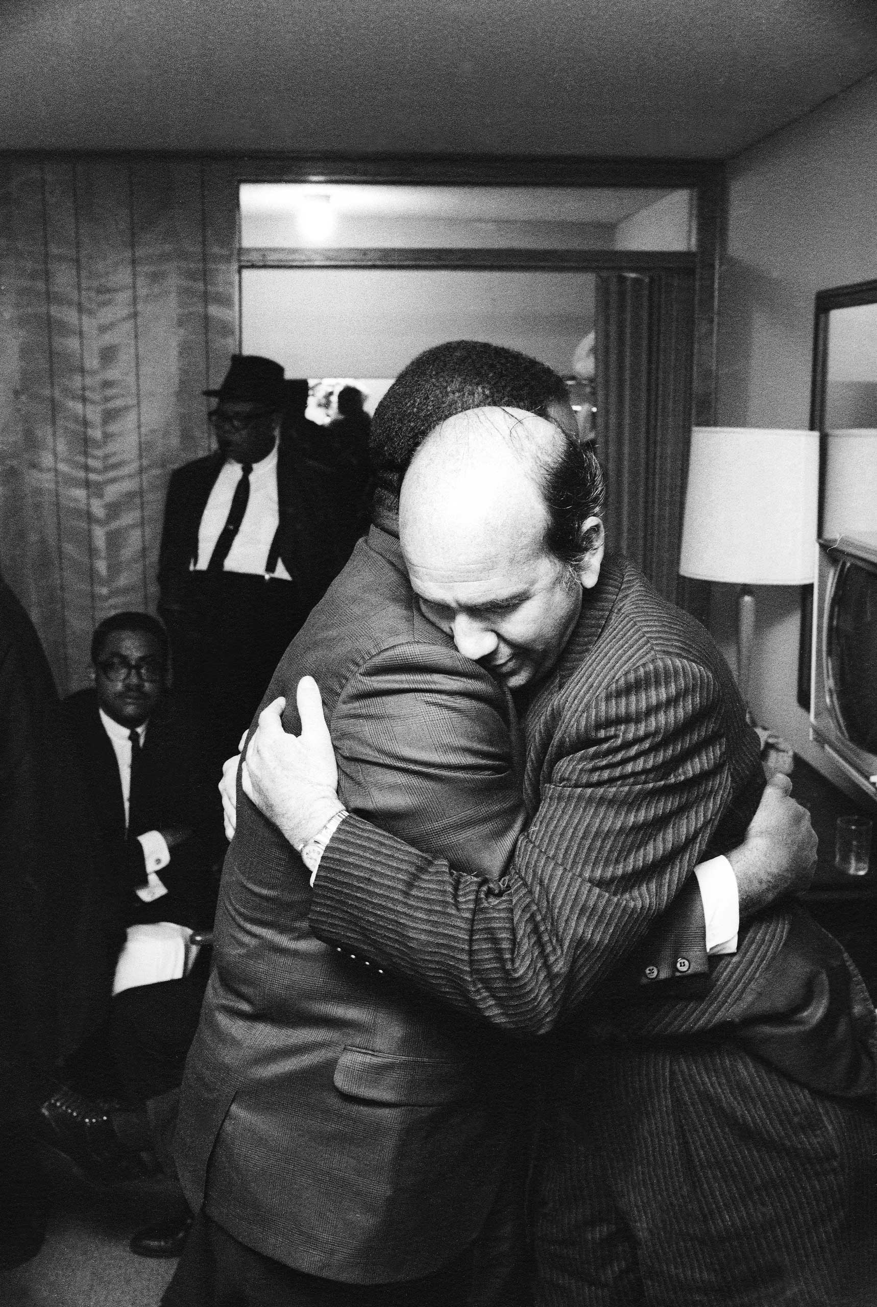 """<b>Not published in LIFE.</b> Ralph Abernathy and Will D. Campbell, a long-time friend and civil rights activist, embrace in Dr. King's room. """"I was documenting a momentous event,"""" Groskinsky told LIFE.com, """"and I thought that at any time I was going to be asked to leave, so I did what I could as quickly as I could."""""""