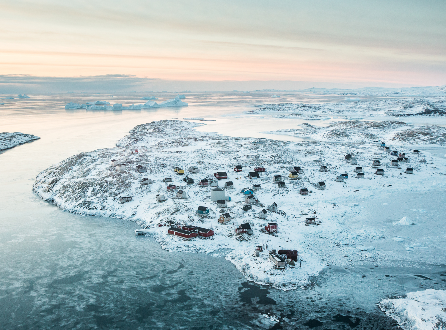 A view from the helicopter while flying over the pack ice from Tasiilaq to Isortoq—population 64—in eastern Greenland.