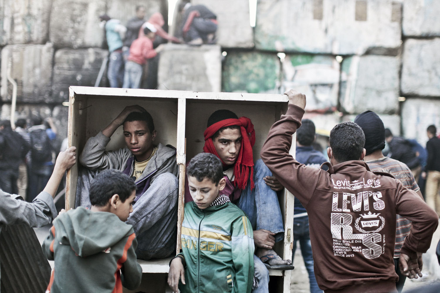 Protesters take shelter during clashes with the Egyptian police on the second anniversary                               of the revolution, Cairo, January, 2013.