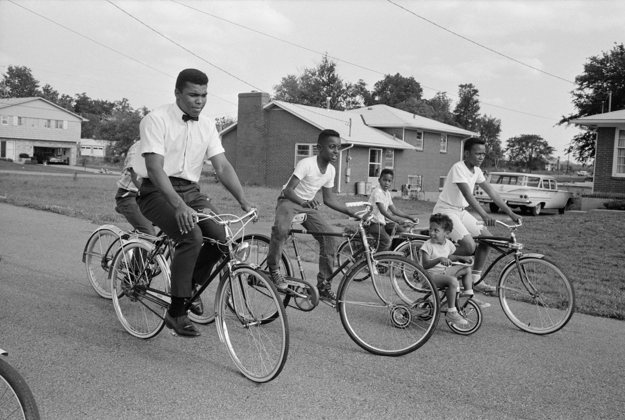 Clay, soon to be known as Muhammad Ali, bicycles near his parents' house in Louisville, Ky., circa 1963.