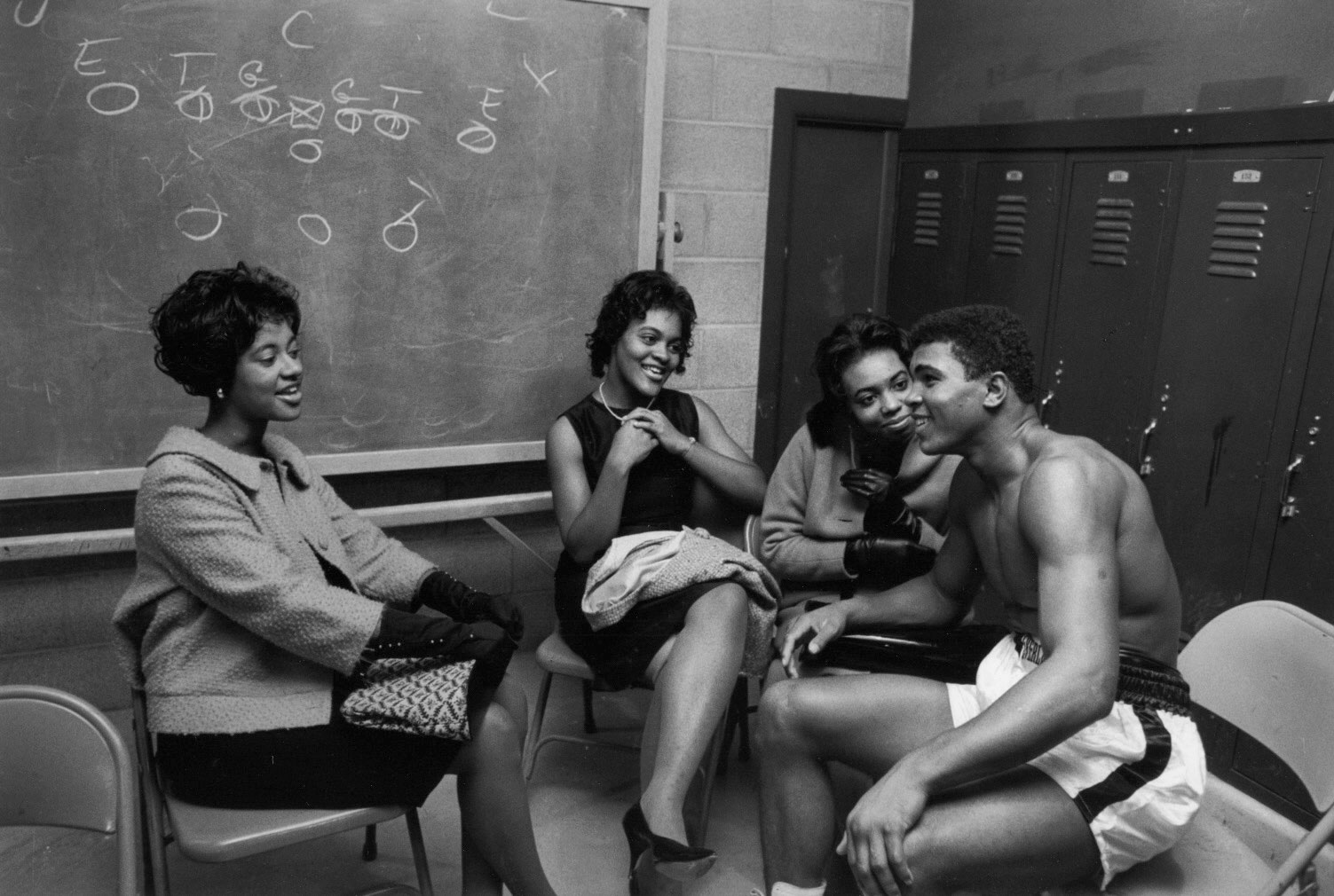 Ali talks to admirers and relatives in the basement of an arena before a fight on Oct. 7, 1961, in Louisville, Ky.