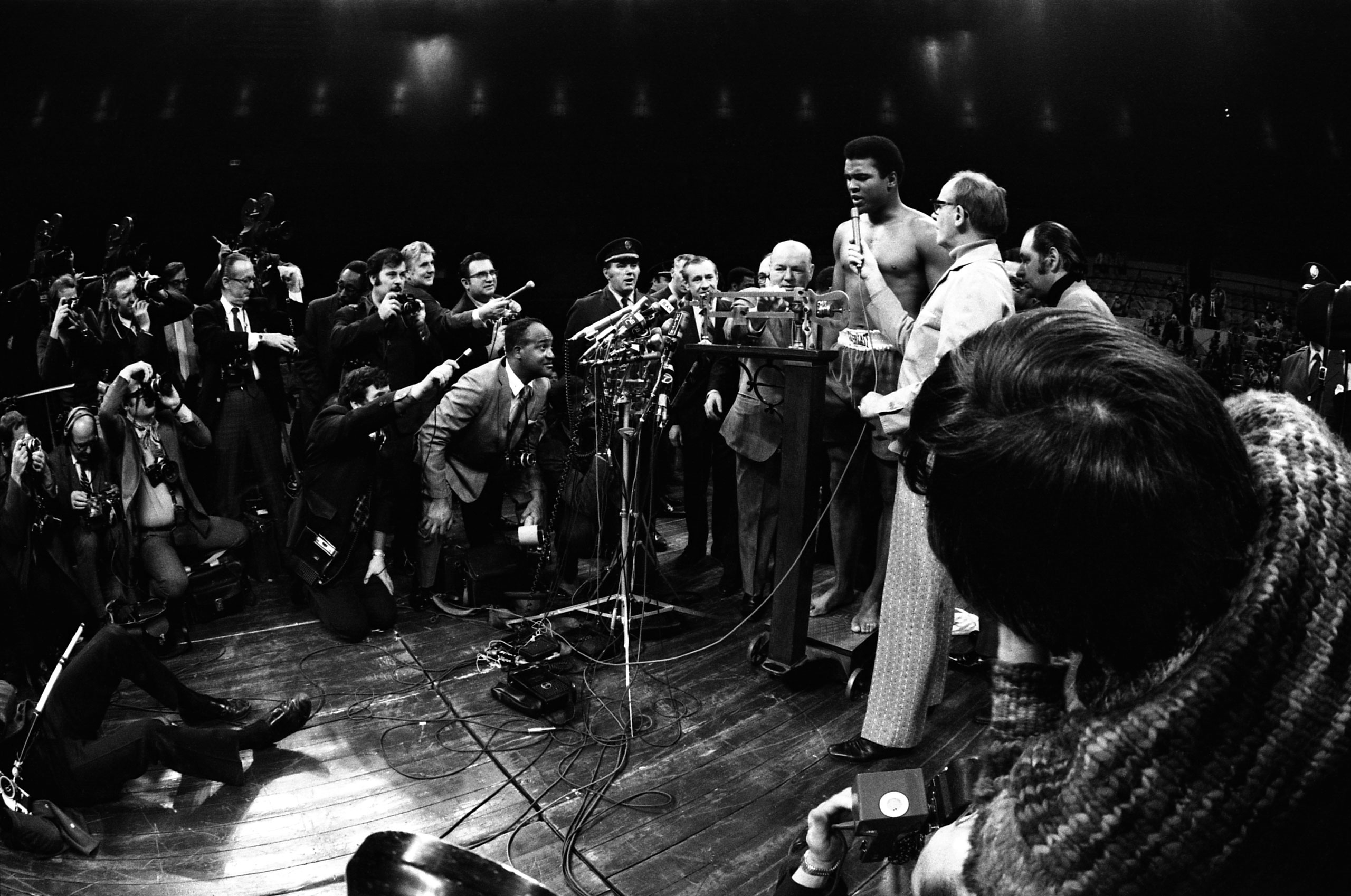 Ali speaks to the press during a pre-fight weigh-in at Madison Square Garden in New York City in March 1971 ahead of what would become known as The Fight of the Century where Ali would go 15 rounds with champion Joe Frazier.