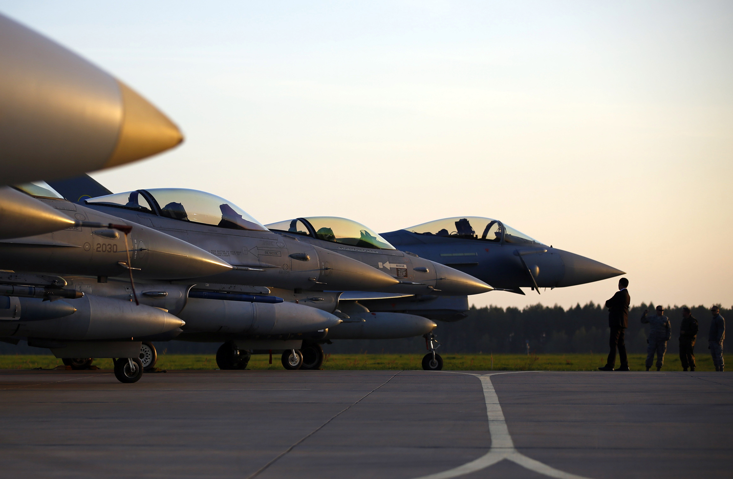 Military aircraft are seen on the tarmac during a visit by the new NATO Secretary General Jens Stoltenberg of Norway at Lask Air Base, in Poland, on Oct. 6, 2014