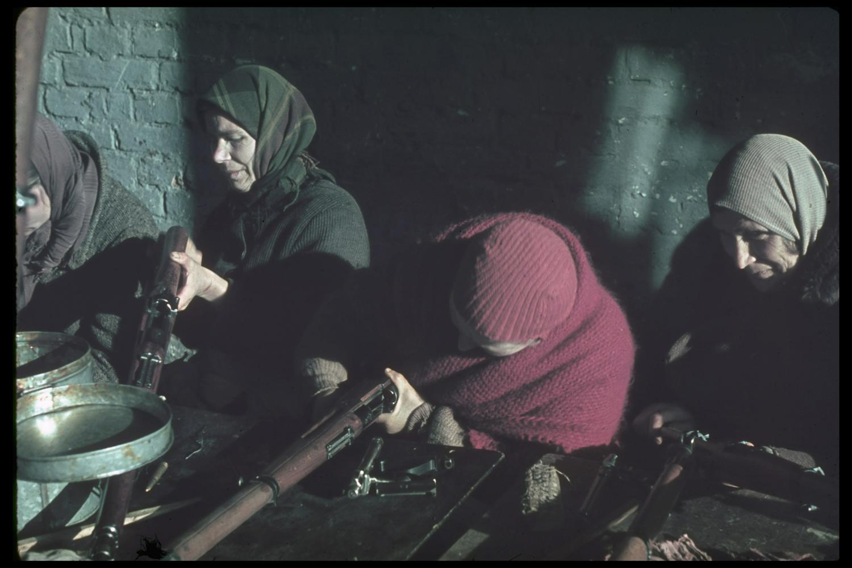 Polish women clean captured Polish guns in Modlin Fortress, north of Warsaw, 1939.