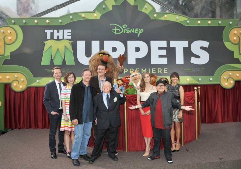 From Left: Actors Neil Patrick Harris, Kristen Schaal, Chris Cooper, Jason Segel, Mickey Rooney, Amy Adams, Rico Rodriguez and Rashida Jones arrive at the premiere of Walt Disney Pictures' 'The Muppets' on Nov. 12, 2011 in Hollywood.