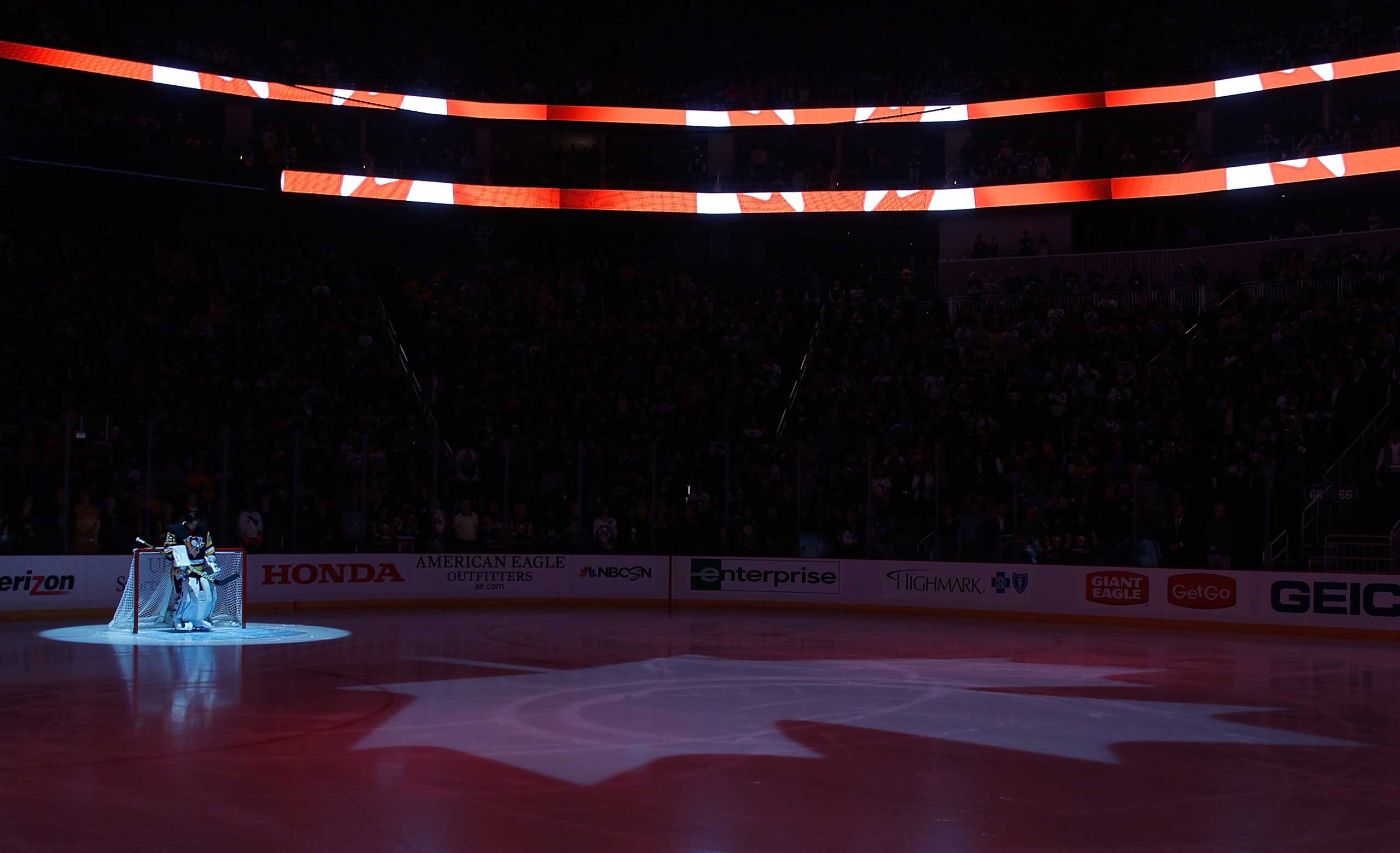 The Canadian National Anthem is performed in honor of the shooting victims in Ottawa during the game between the Philadelphia Flyers and Pittsburgh Penguins at Consol Energy Center on Oct. 22, 2014 in Pittsburgh, Pa.