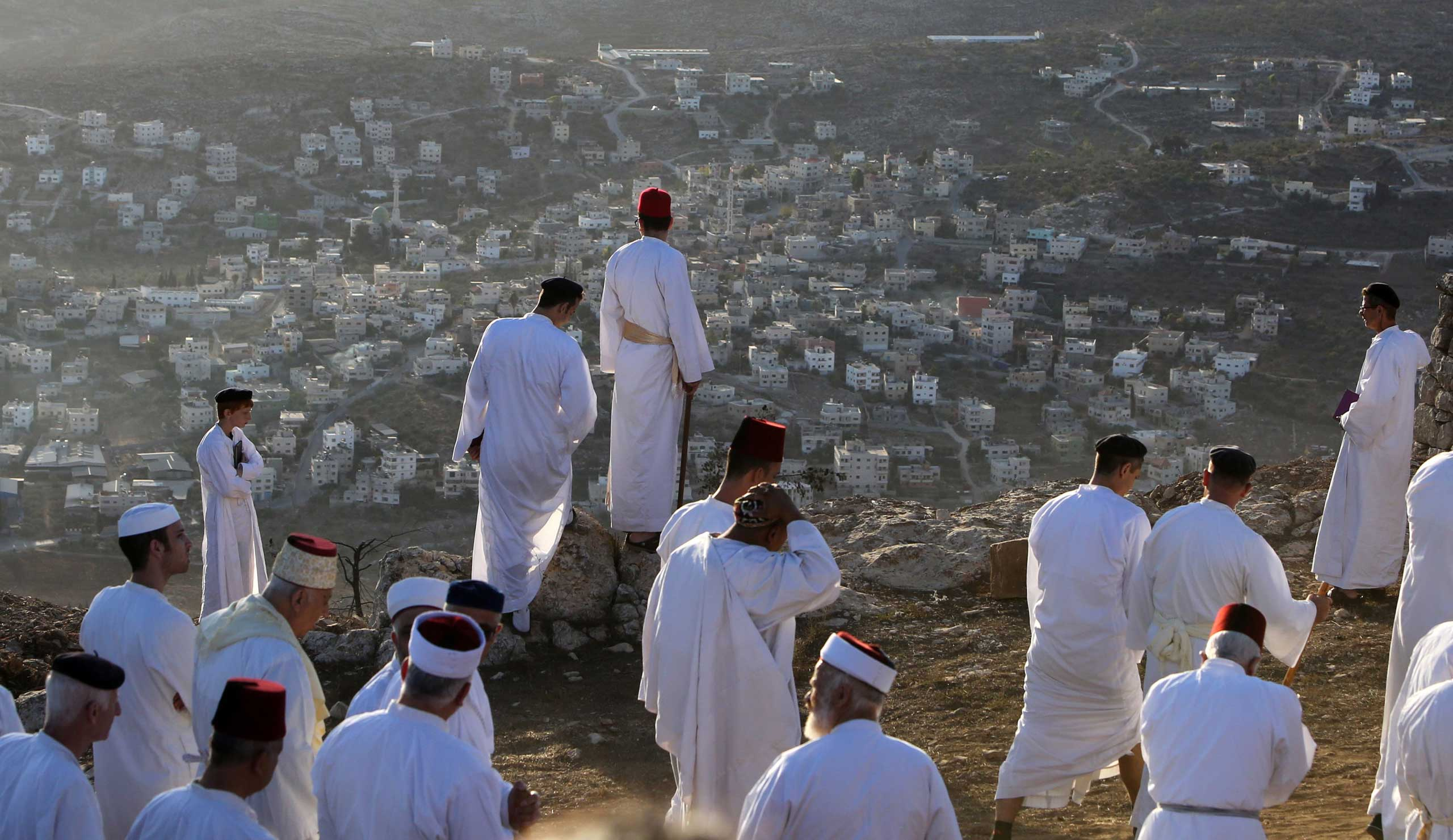 Oct. 8, 2014. Samaritans take part in celebrations marking the holiday of Sukkot (the Tabernacles Feast) on Mount Gerizim, near the northern West Bank city of Nablus. Sukkot marks the exodus of the ancient Hebrew people from Egypt.