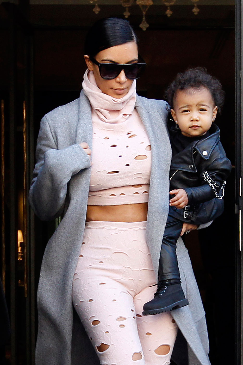 Kim Kardashian heads out for the airport with daughter North West in Paris, France on Oct. 1, 2014.