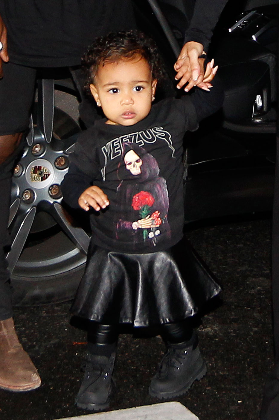 Kanye West, Kim Kardashian and their daughter North West walk to the Balenciaga Womenswear Spring/Summer 2015 during Paris Fashion Week in Paris, France on Sept. 24, 2014.